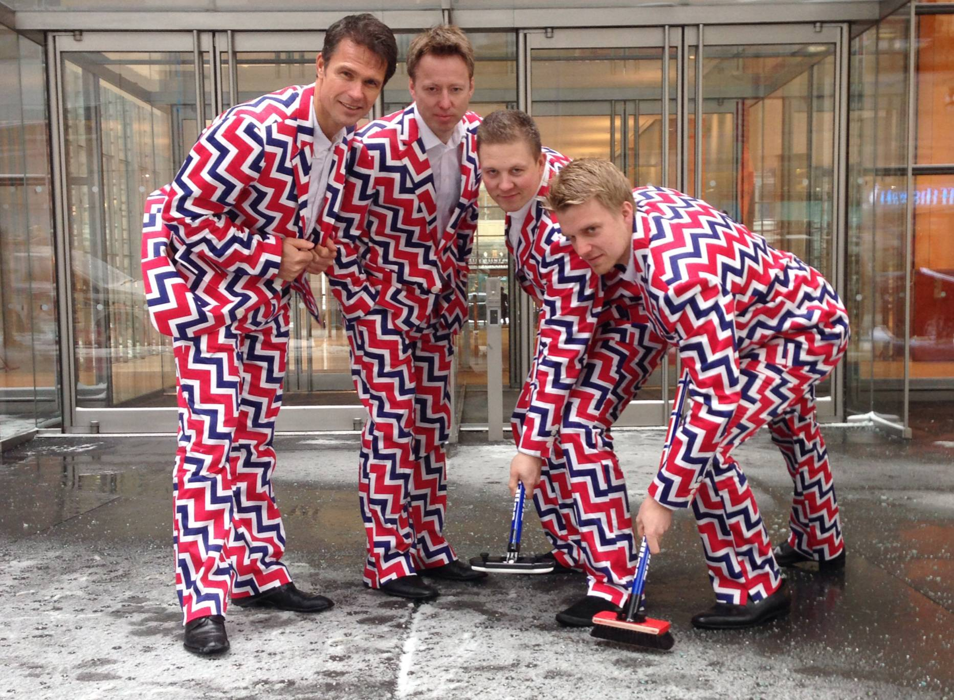 Associated PressMembers of the Norway's Men's Olympic Curling Team from left, Thomas Ulsrud, Torgor Nergard, Christoffer Svae, and Havard Vad Petersson wear their new Sochi 2014 suits as they pose for a photographer in New York.