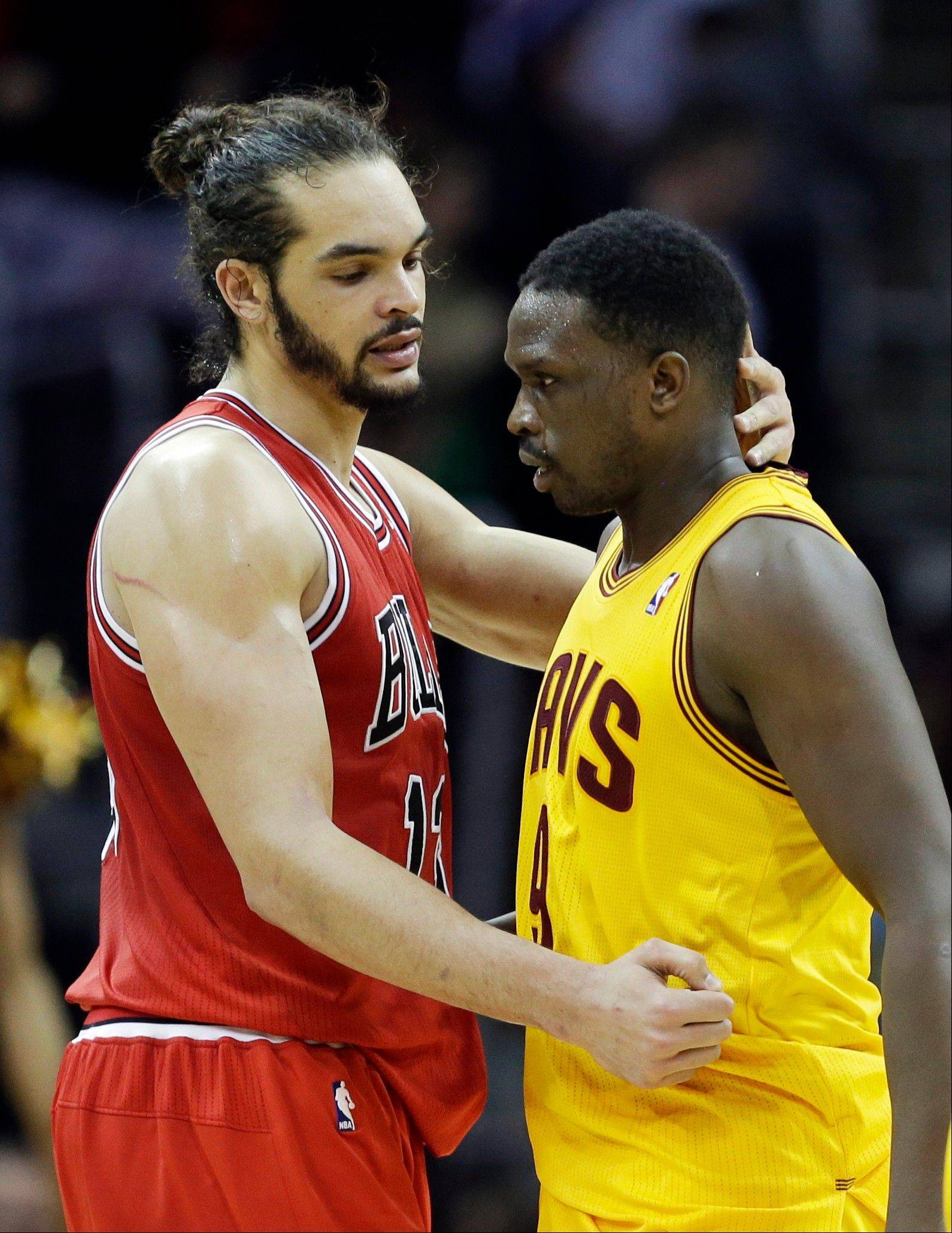 Tne Bulls' Joakim Noah embraces former teammate Luol Deng after the Bulls' victory over Deng and his new team, the Cleveland Cavaliers.