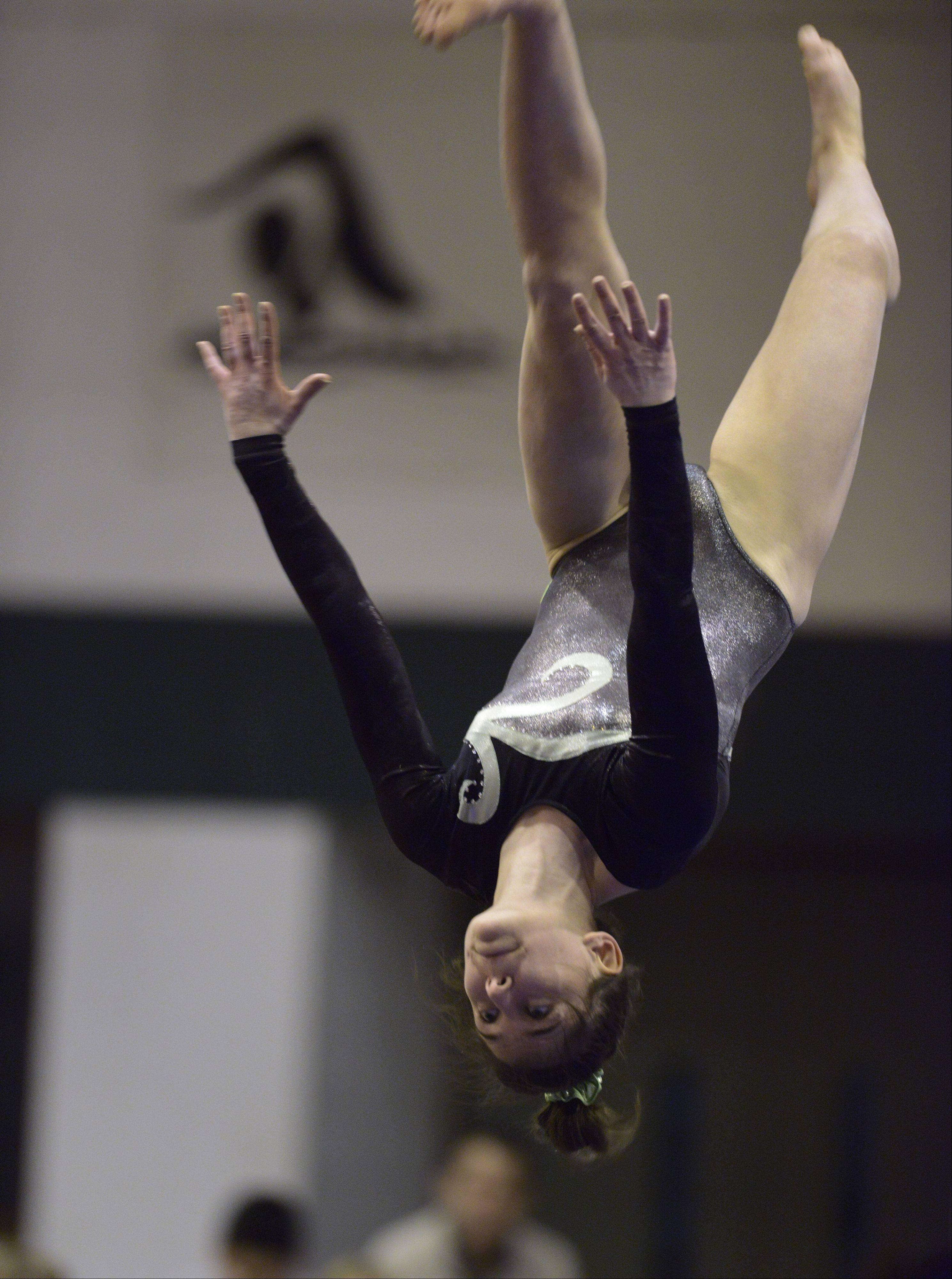 Elk Grove's Amelia Rafferty competes on the balance beam during Wednesday's meet with Buffalo Grove and Prospect.
