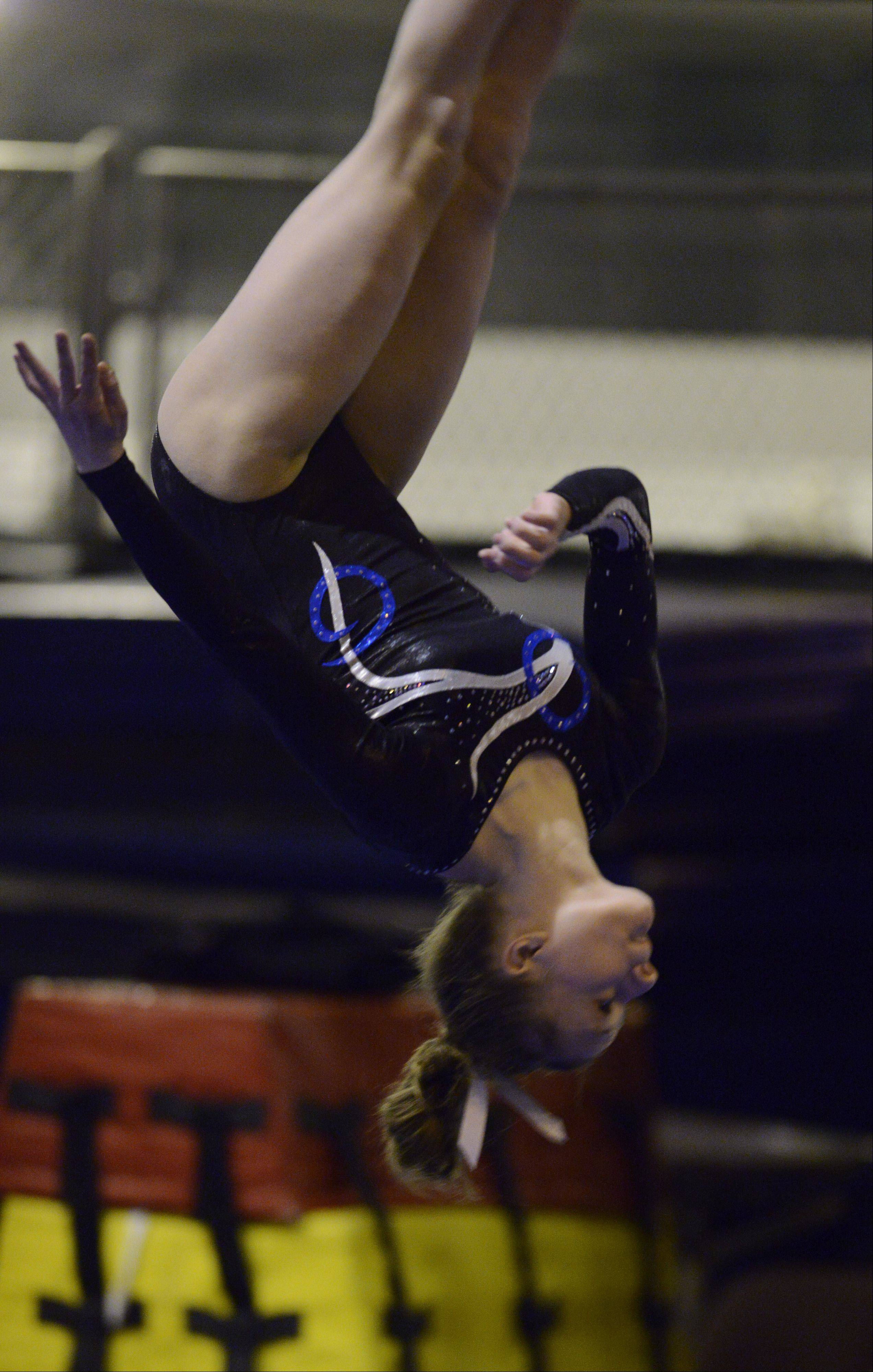 Prospect's Maddie Larock competes on the floor exercise during Wednesday's meet with Buffalo Grove and host Elk Grove.