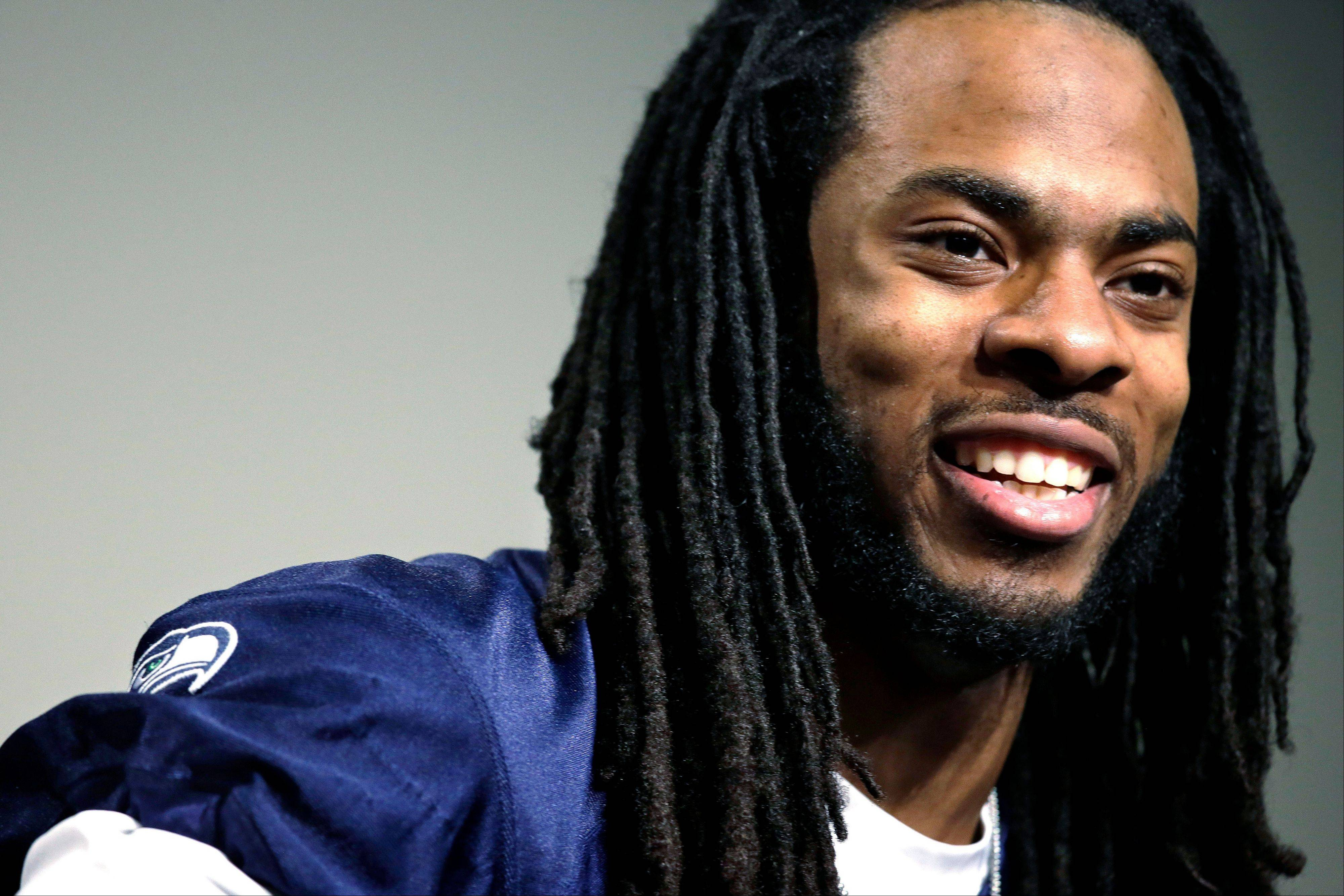 Seattle Seahawks' Richard Sherman speaks during a news conference Wednesday, Jan. 22, 2014, in Renton, Wash. The Seahawks play the Denver Broncos in the NFL football Super Bowl on Feb. 2.