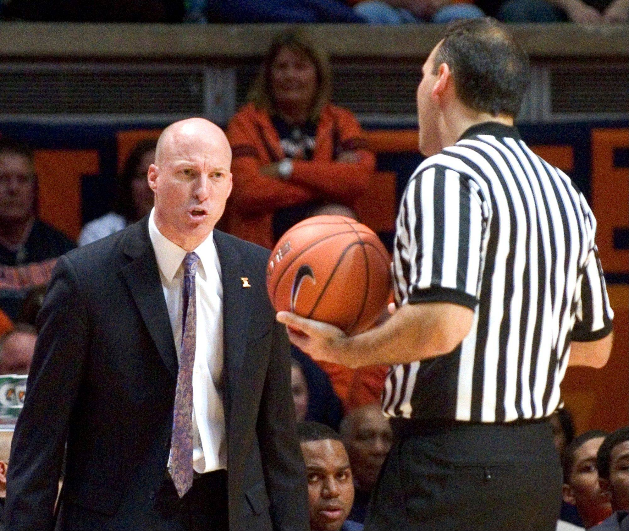FILE - In this Jan. 18, 2014, file photo, Illinois head coach John Groce has words with a referee during Illinois' 78-62 loss to Michigan State in an NCAA college basketball game in Champaign, Ill. Groce said Wednesday, Jan. 22, 2014, that he went too far in a series of outbursts during the loss.