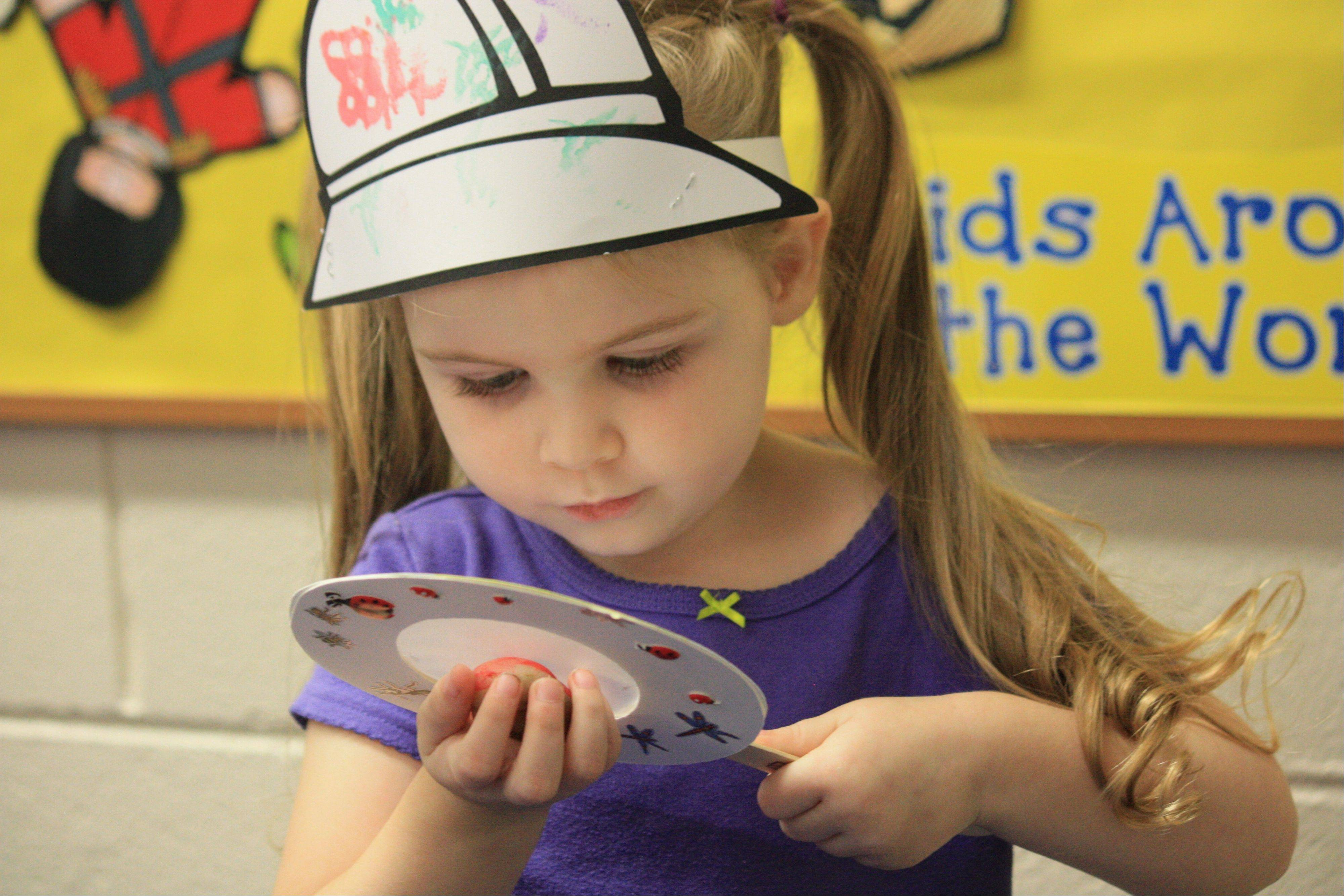 A student at Maple Park Preschool enjoys the annual Bug Hunt. Registration for the 2014-15 Palatine Park District Preschool year begins Monday, Feb. 3 for residents.