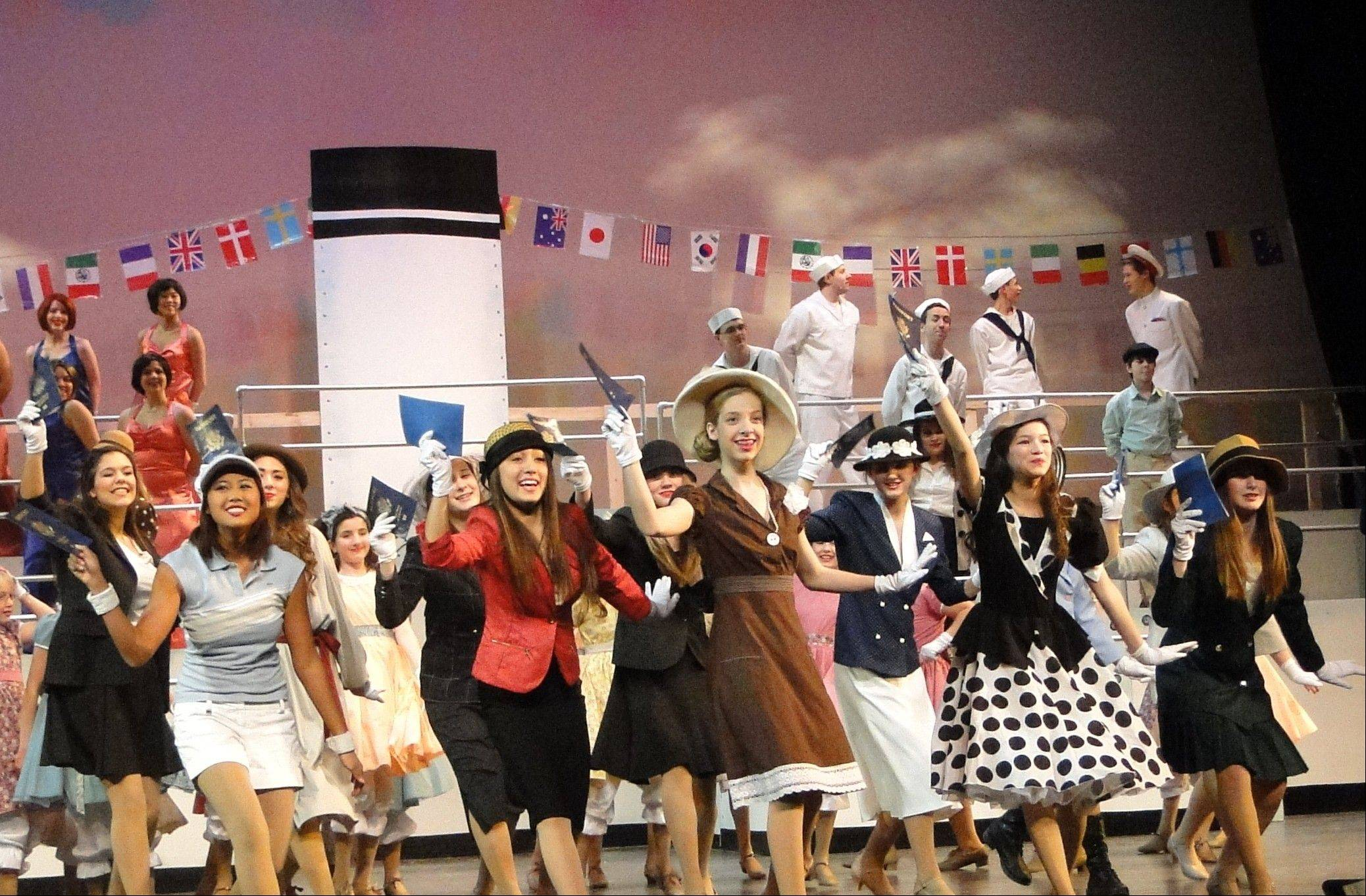 "The Schaumburg on Stage cast performs the song ""Bon Voyage"" during dress rehearsal Tuesday for the Broadway musical ""Anything Goes,"" being performed at Schaumburg Prairie Center for the Arts."