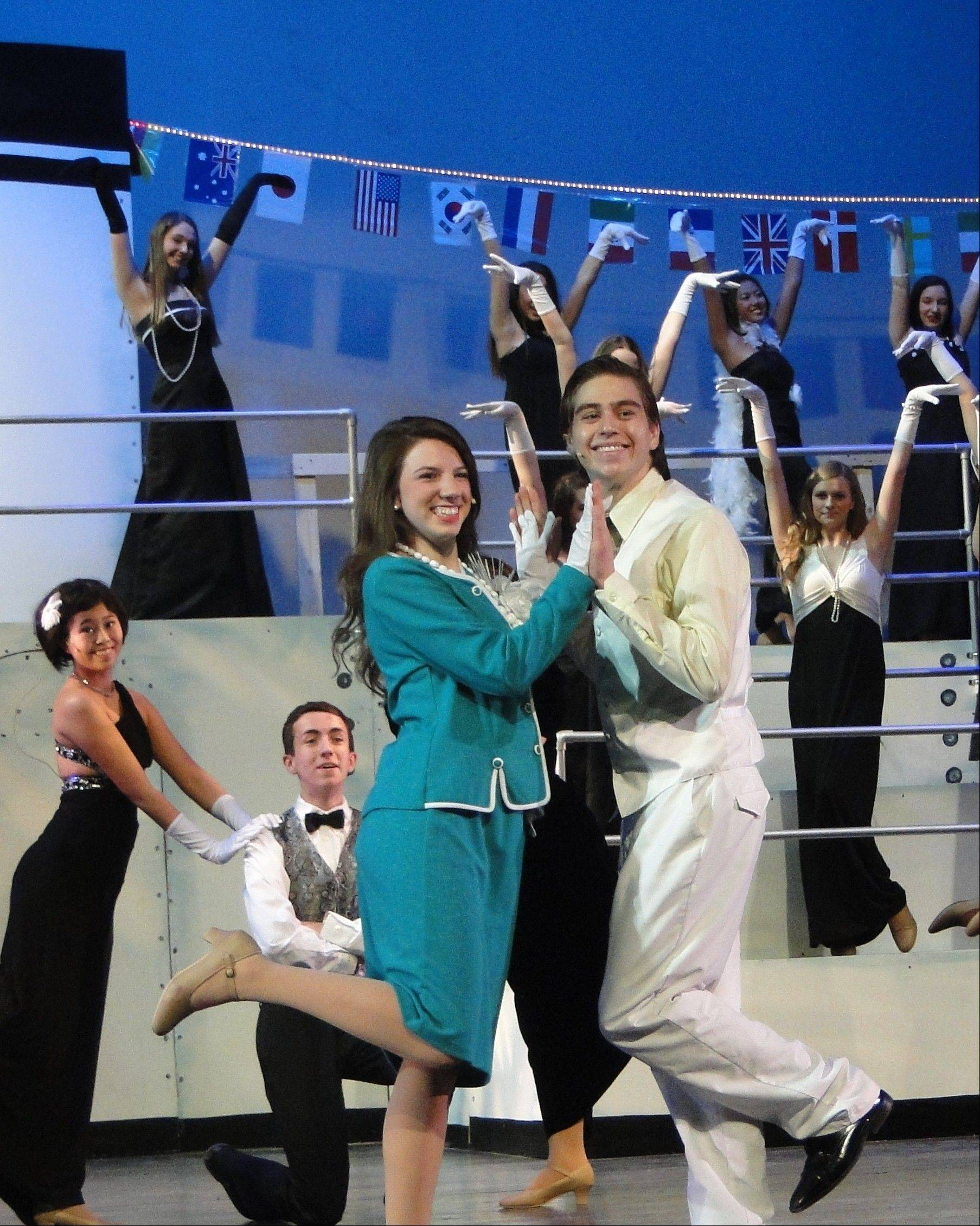 "Performing ""It's Delovely"" are, from left, in front Kathleen Tresnowski as Hope Harcourt and RJ Cecott as Billy Crocker. Schaumburg on Stage is producing the Broadway musical ""Anything Goes"" at Schaumburg Prairie Center for the Arts."