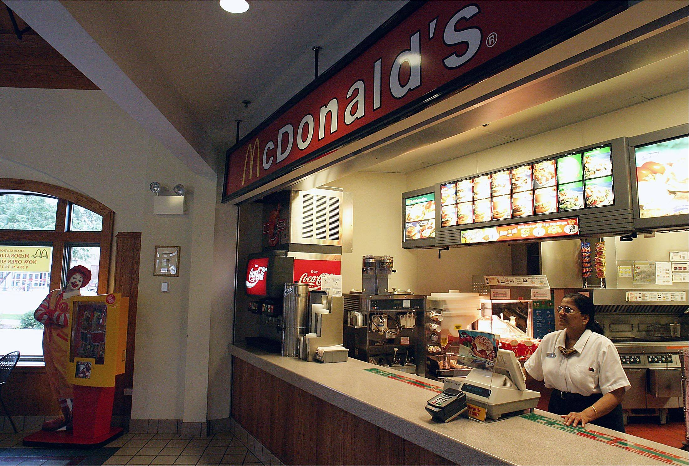 Oak Brook-based McDonald's reported disappointing quarterly sales Thursday as fewer customers visited the world's biggest hamburger chain.
