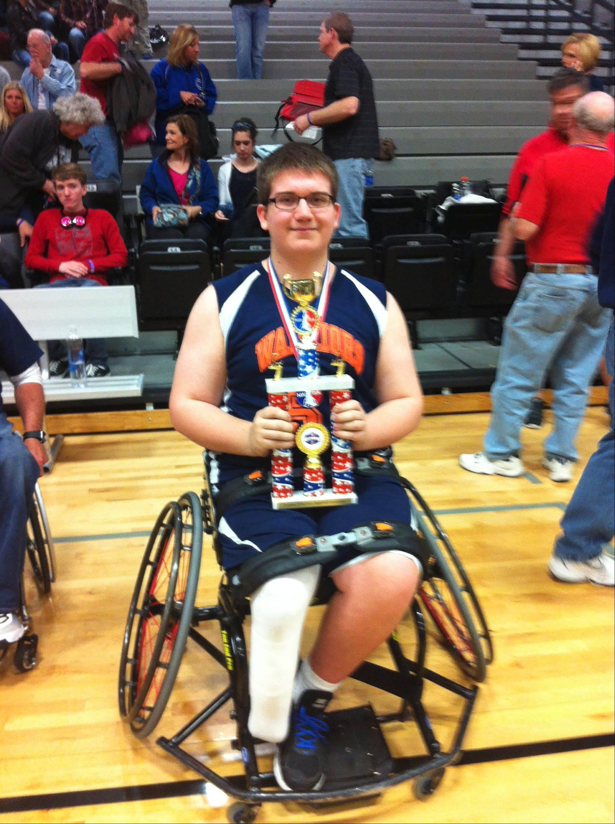 Dan Dye, a student at Waubonsie Valley High School in Aurora, plays on the Windy City Warriors wheelchair basketball team.