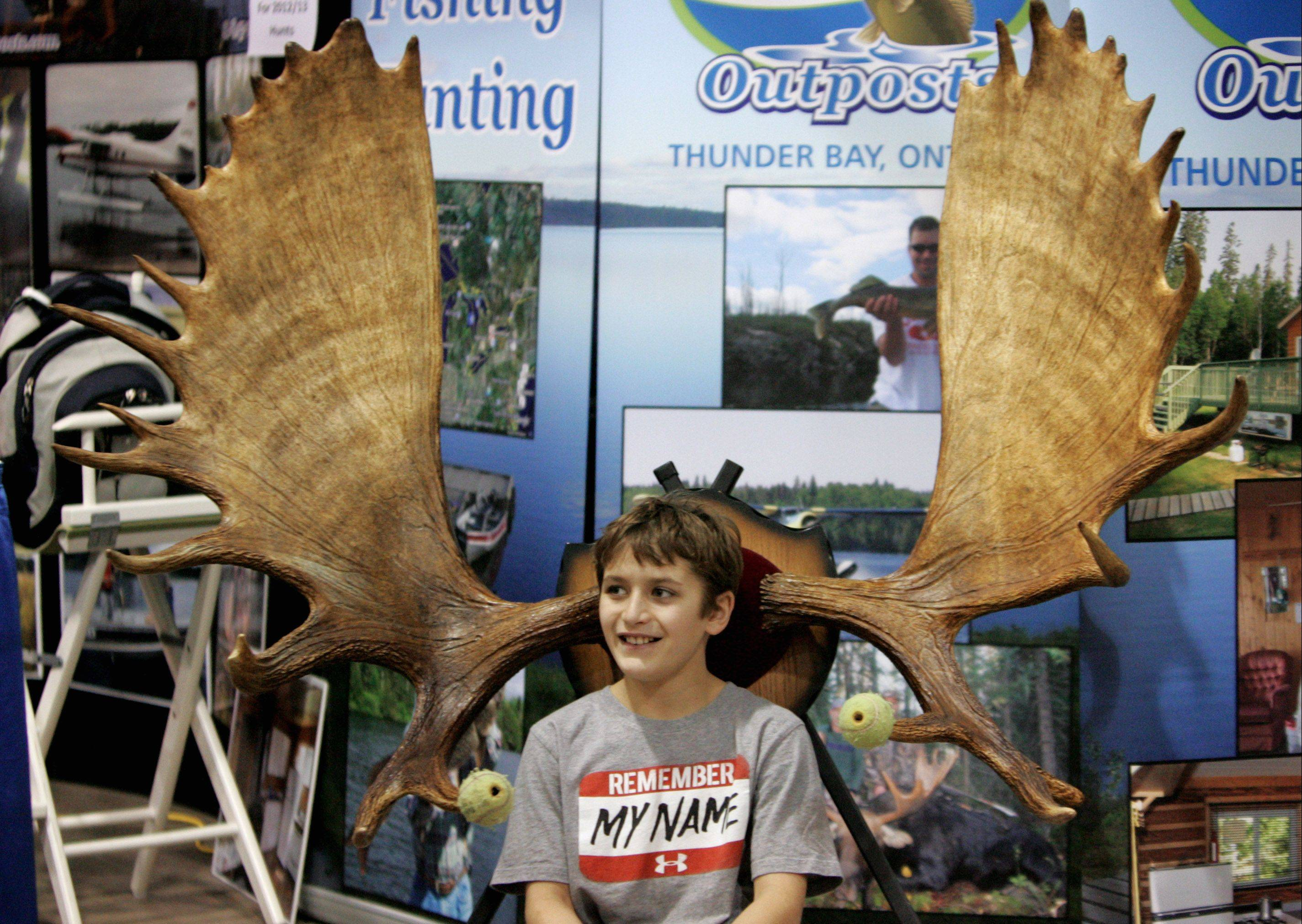 Sammy Silich of Long Grove at the Thousand Lakes Outposts booth during the Chicago Outdoor Sportsmen Show in Rosemont.
