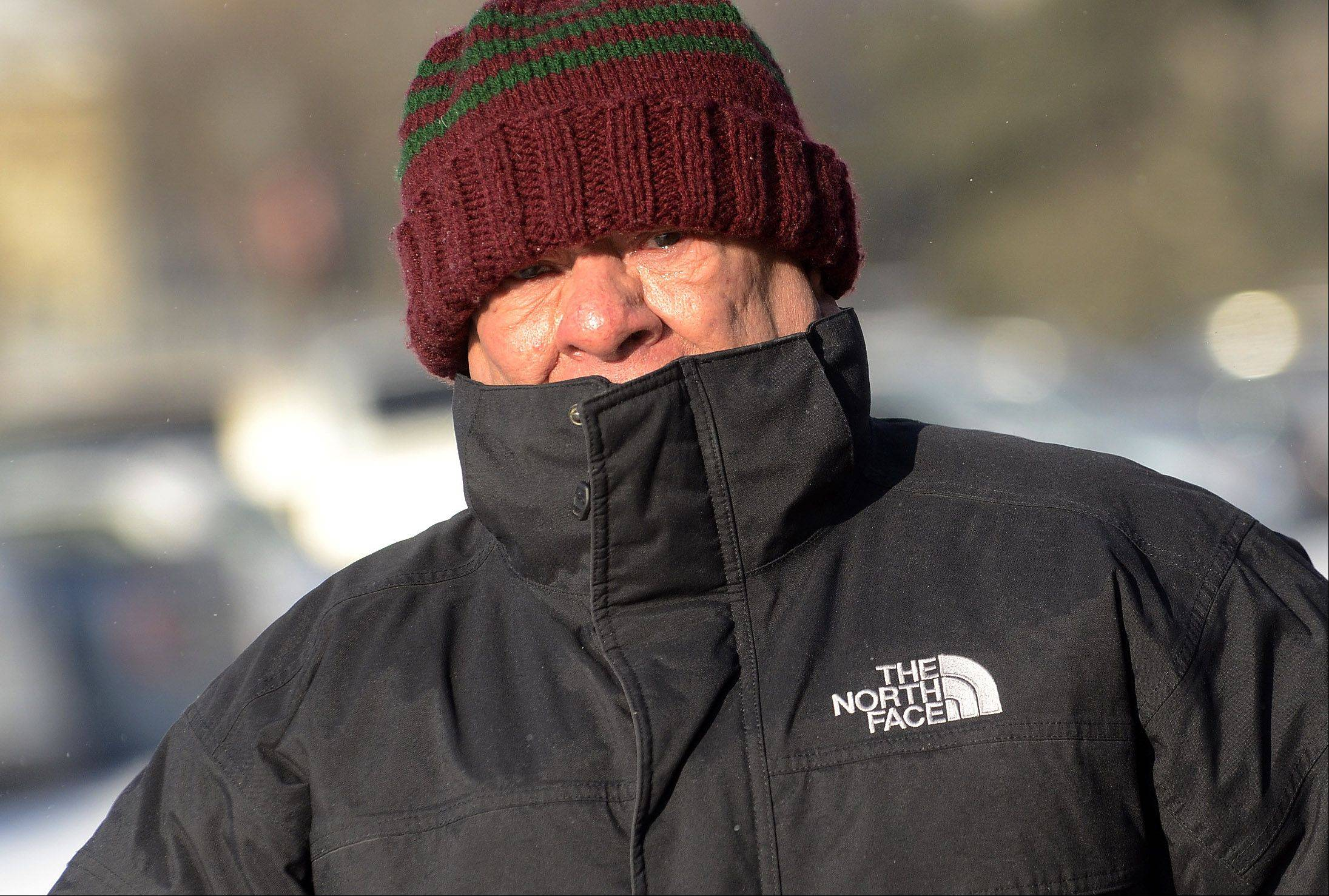 Bob Chwedyk/bchwedyk@dailyherald.com Alfredo Faries of Barrington bundles up at the Barrington Metra station Thursday morning.