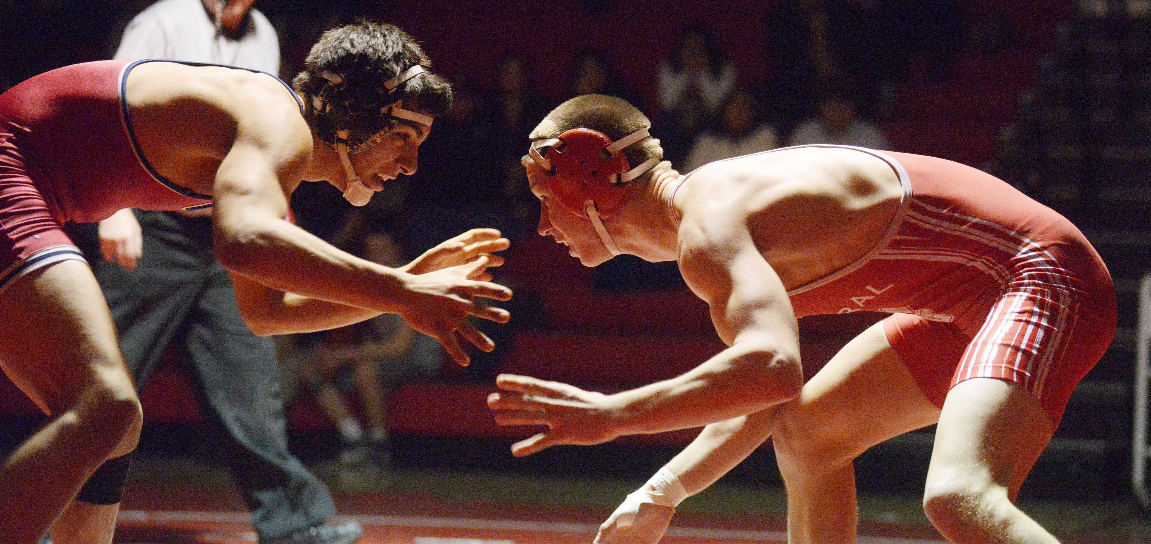 Baranon Farias, left, of West Aurora and Rick Marciniak of Naperville Central battle in the 152-pound match during the West Aurora at Naperville Central wrestling meet Thursday.