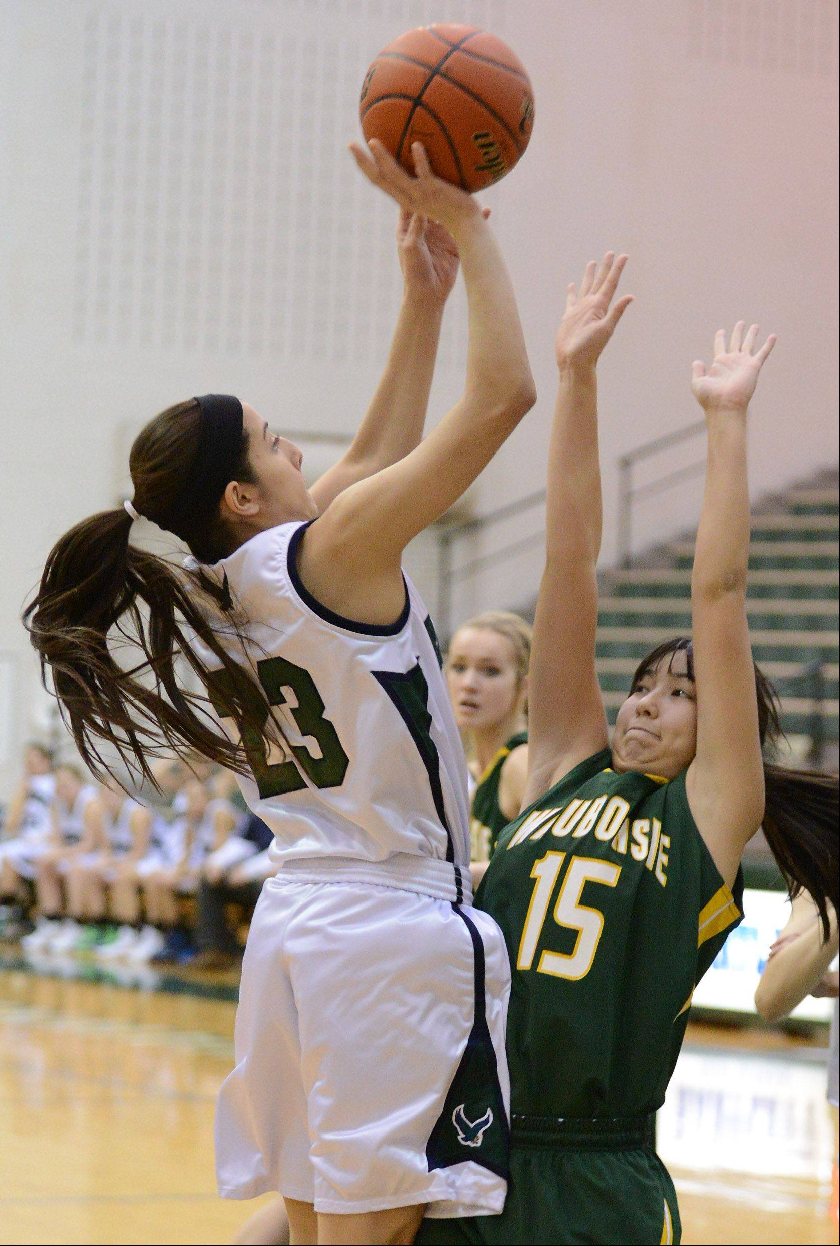 Bartlett�s Ally Giampapa (23) shoots over Waubonsie Valley�s Rachael Pedersen (15) during Thursday�s game in Bartlett.