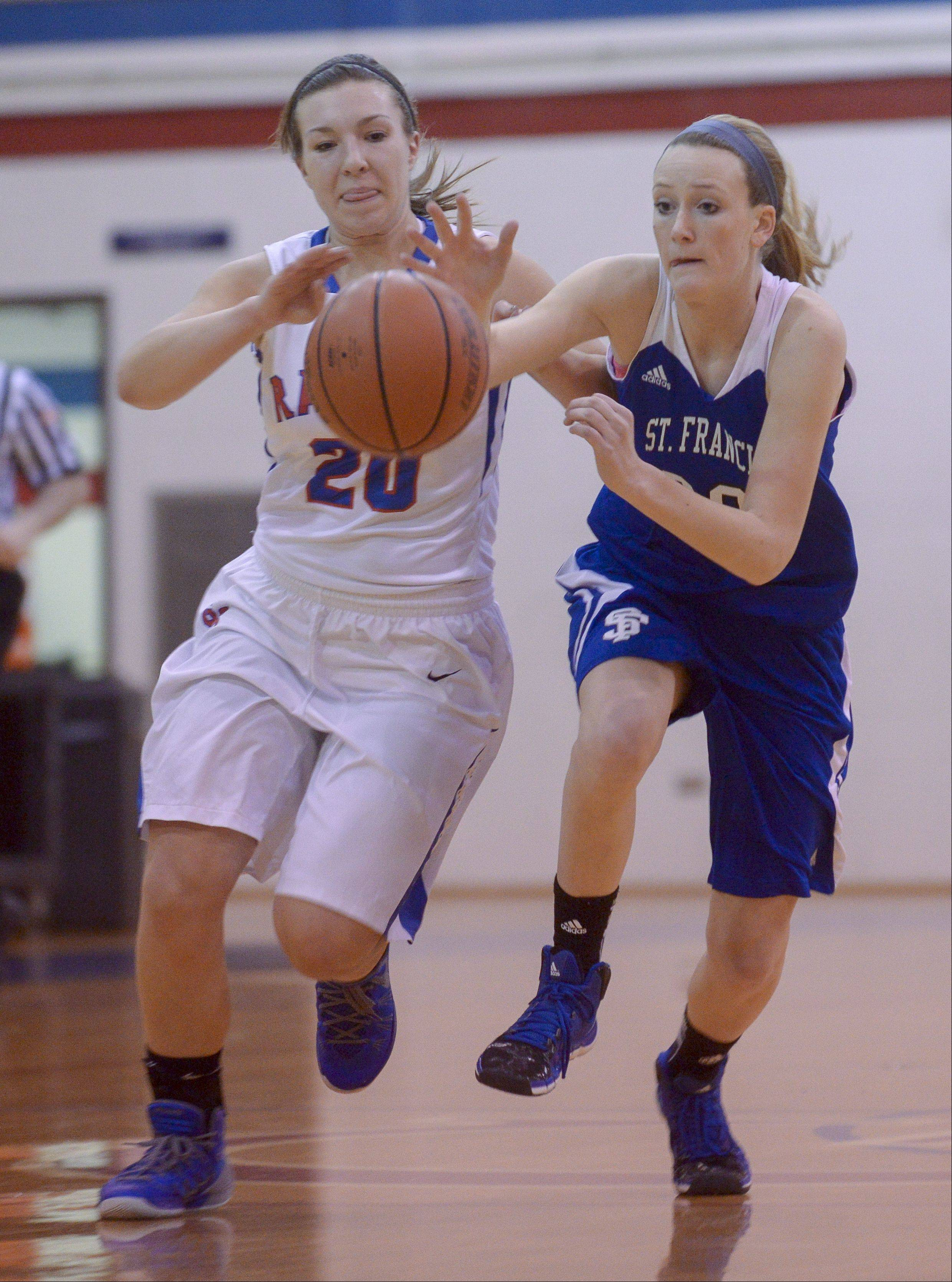 Glenbard South�s Megan Smith and St. Francis� Caroline Pins scramble for control of the ball during girls basketball at South.