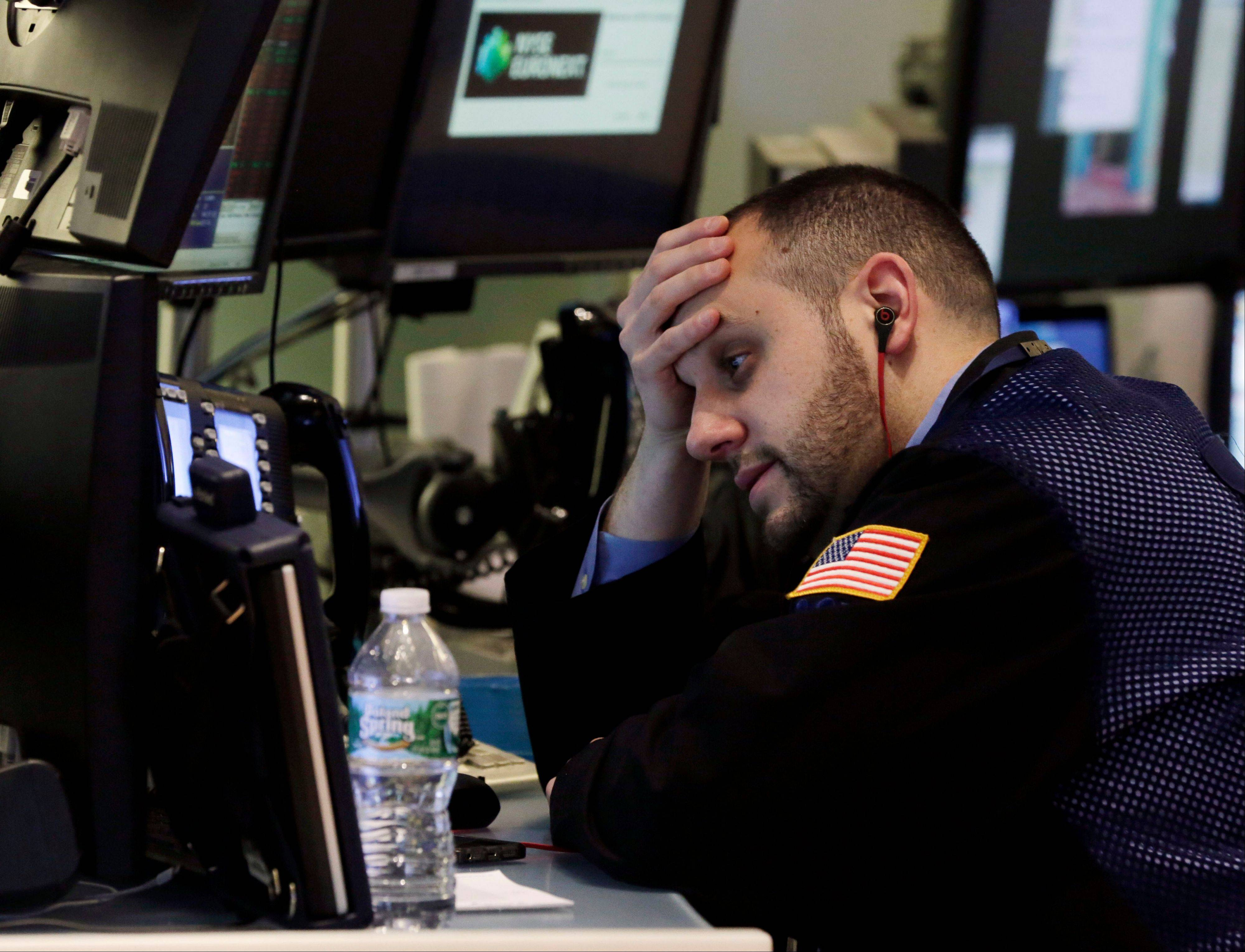 U.S. stocks fell, with the Dow Jones Industrial Average tumbling to a one-month low, after a gauge of China's manufacturing contracted and investors analyzed corporate earnings.