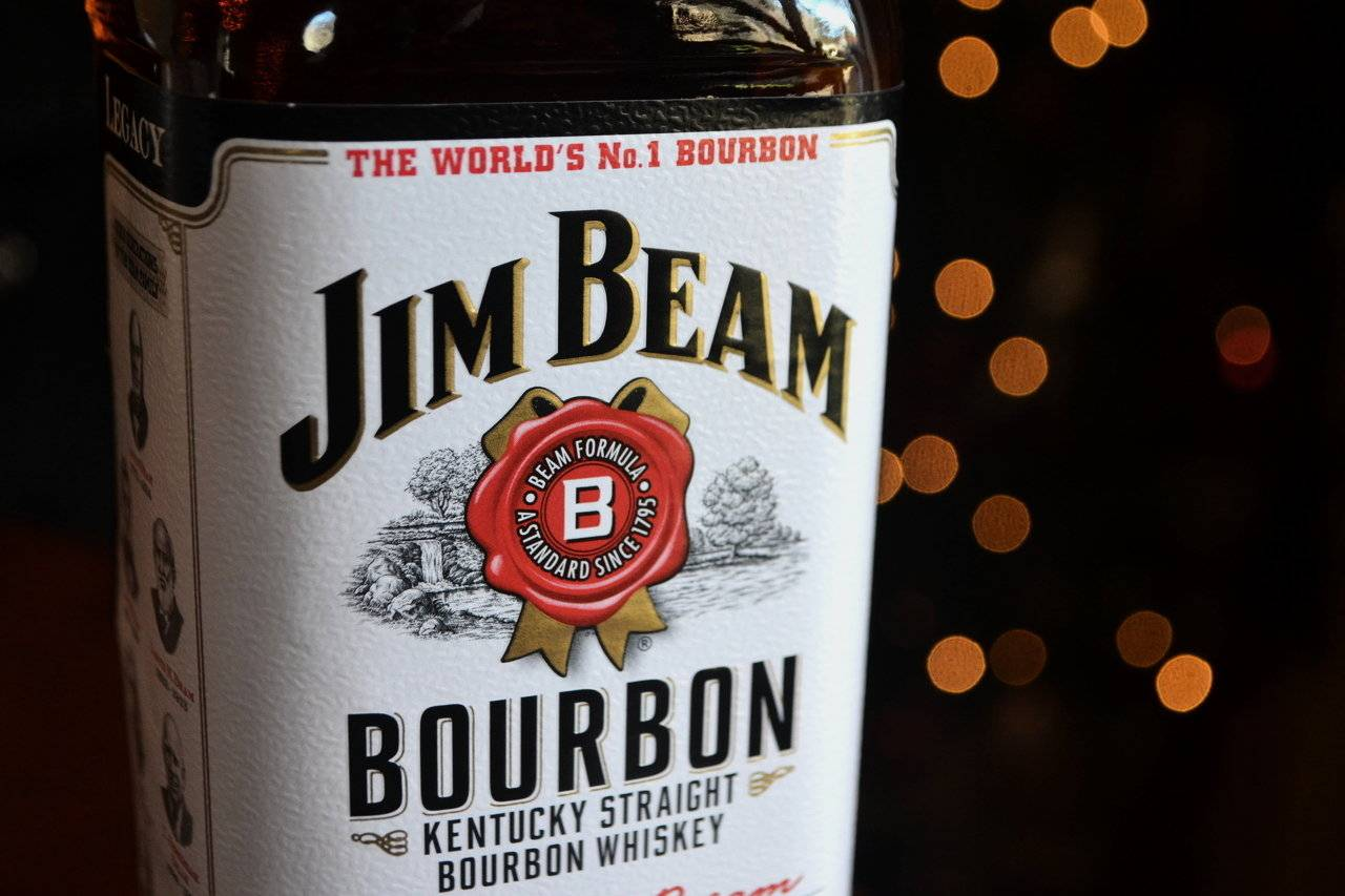 Beam Inc., based in Deerfield, was sued over its proposed $16 billion takeover by Suntory Holdings Ltd. by an investor who said the transaction is being driven by the company's largest shareholder, hedge-fund manager Bill Ackman.