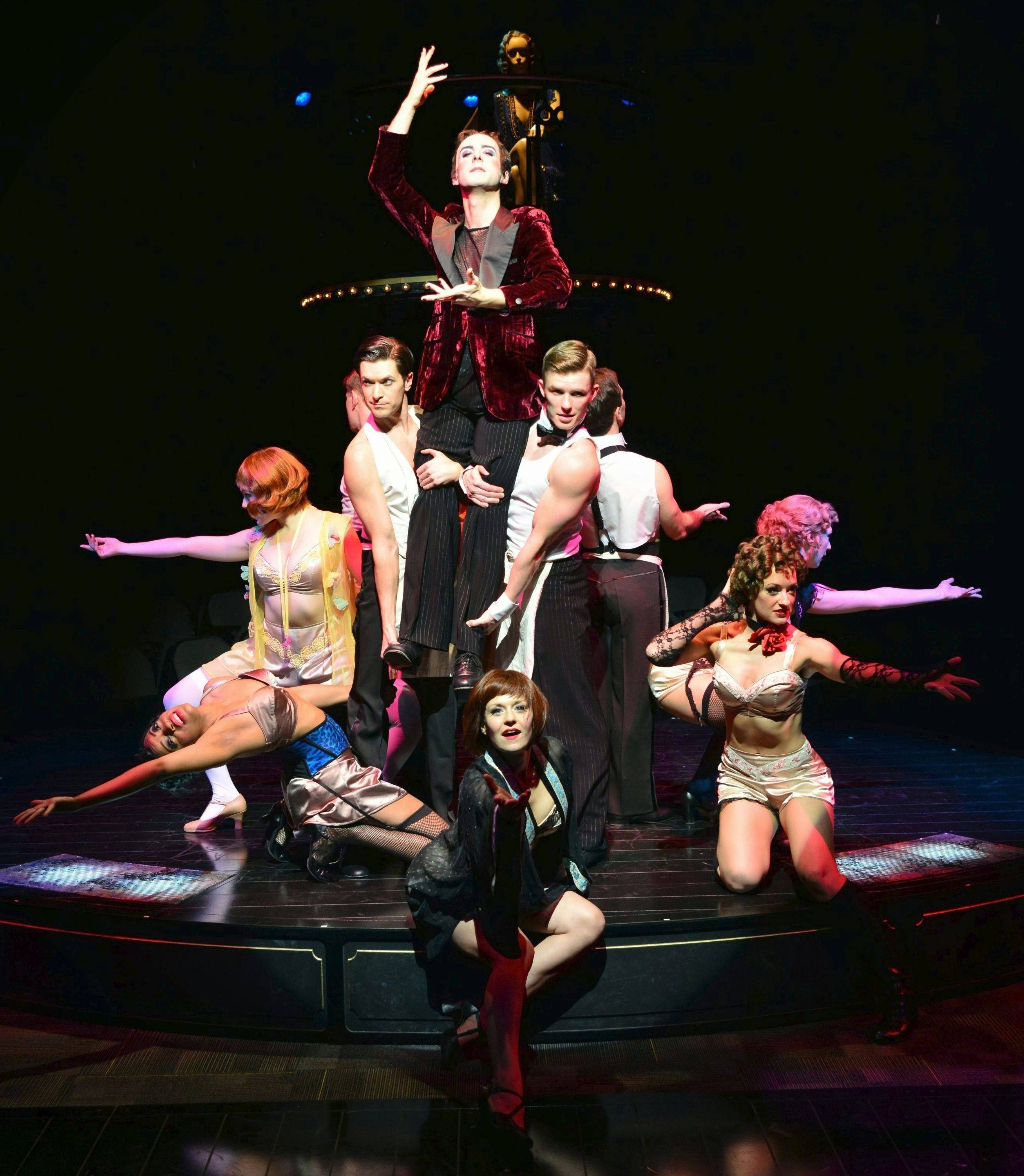 "The Emcee (Stephen Schellhardt, top), Sally Bowles (Megan Sikora, bottom, center) and the dancers at the Kit Kat Klub sing the opening number ""Willkommen"" in the musical ""Cabaret"" at the Marriott Theatre in Lincolnshire."