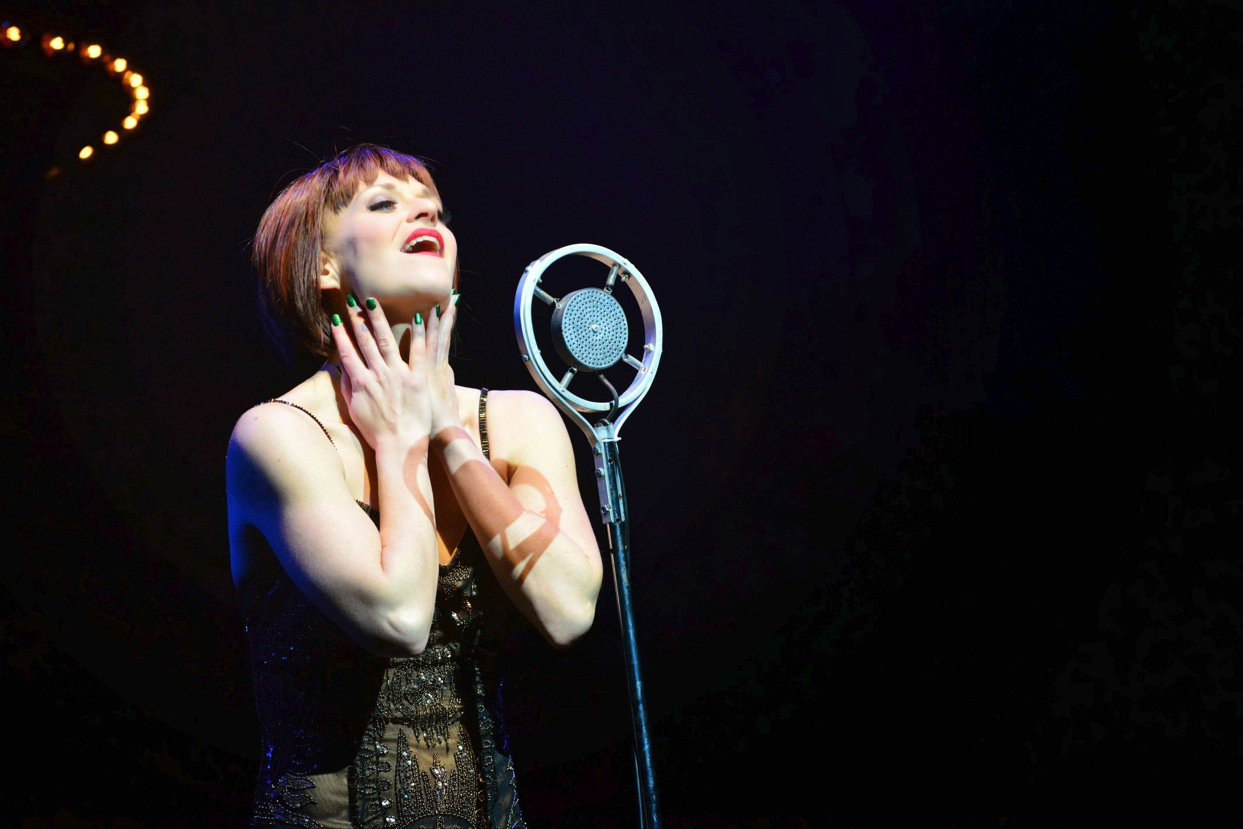 "Sally Bowles (Megan Sikora) hopefully contemplates her love life in the song ""Maybe This Time"" in the musical ""Cabaret"" at the Marriott Theatre in Lincolnshire."