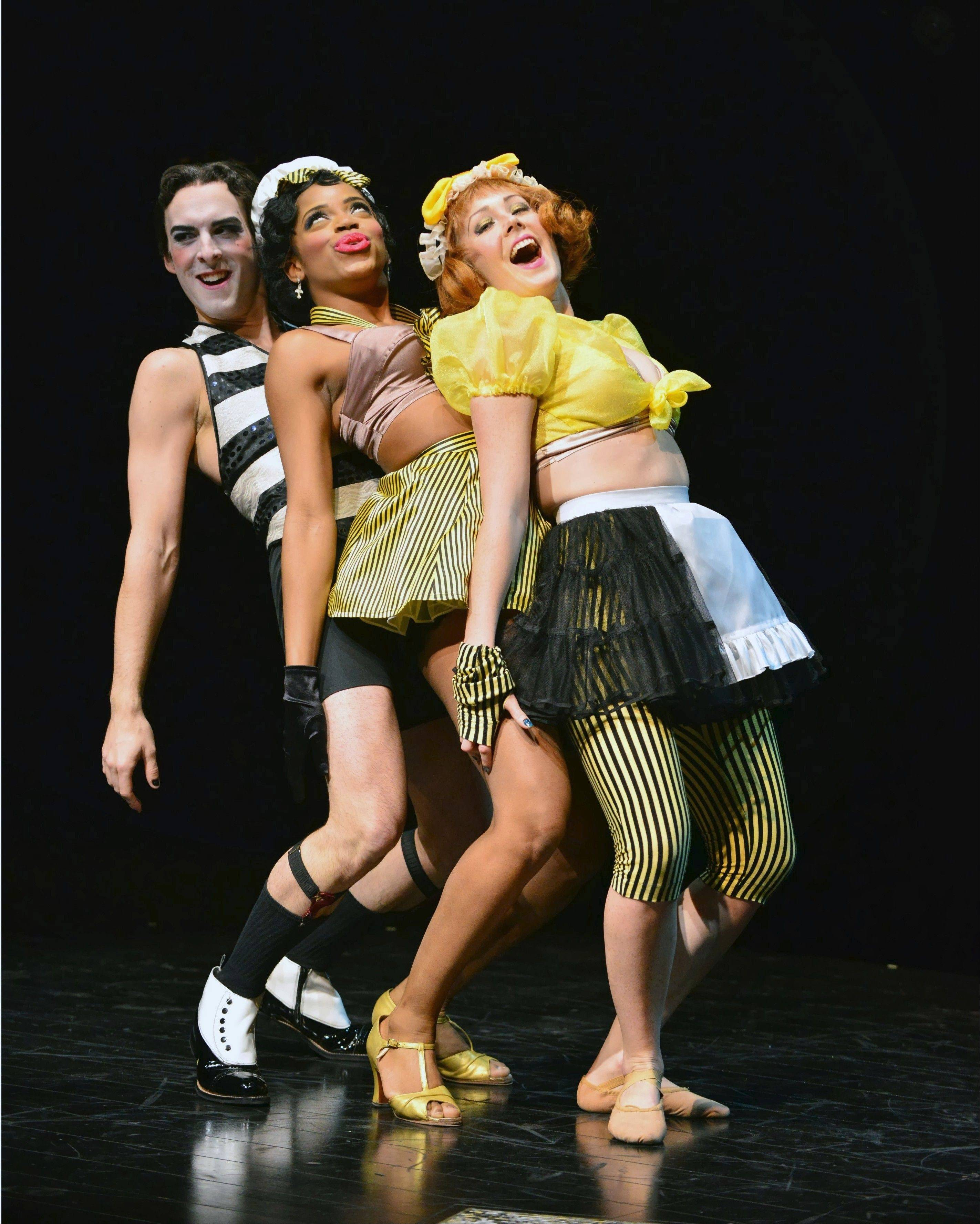"The Emcee (Stephen Schellhardt, left), performs the racy number ""Two Ladies"" with two Kit Kat Klub dancers (Chadae Nichol and Alexandra Palkovic) in the musical ""Cabaret"" at the Marriott Theatre in Lincolnshire."