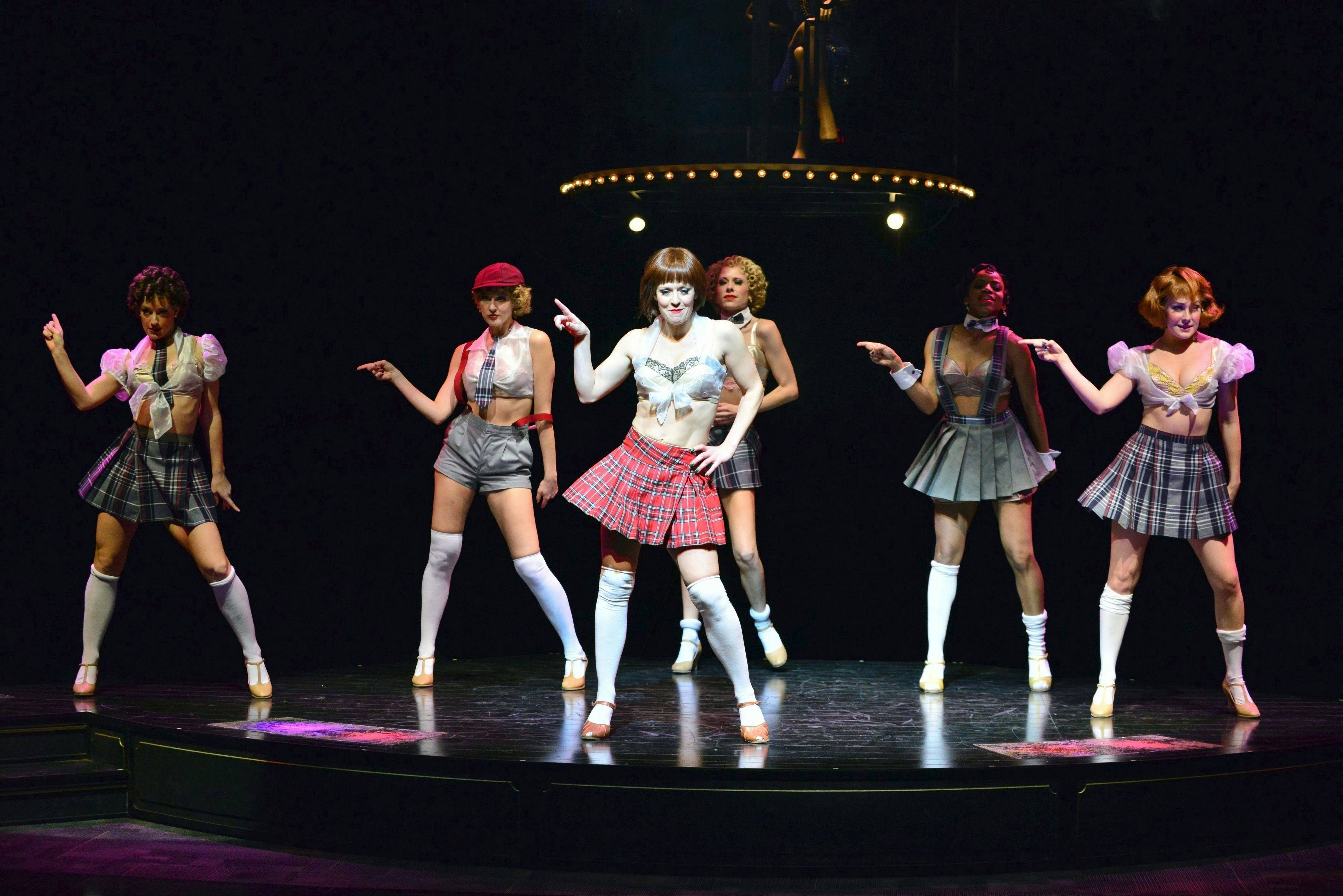 "Sally Bowles (Megan Sikora, center) leads the Kit Kat Klub girls in the production number ""Don't Tell Mama"" in the musical ""Cabaret"" at the Marriott Theatre in Lincolnshire."