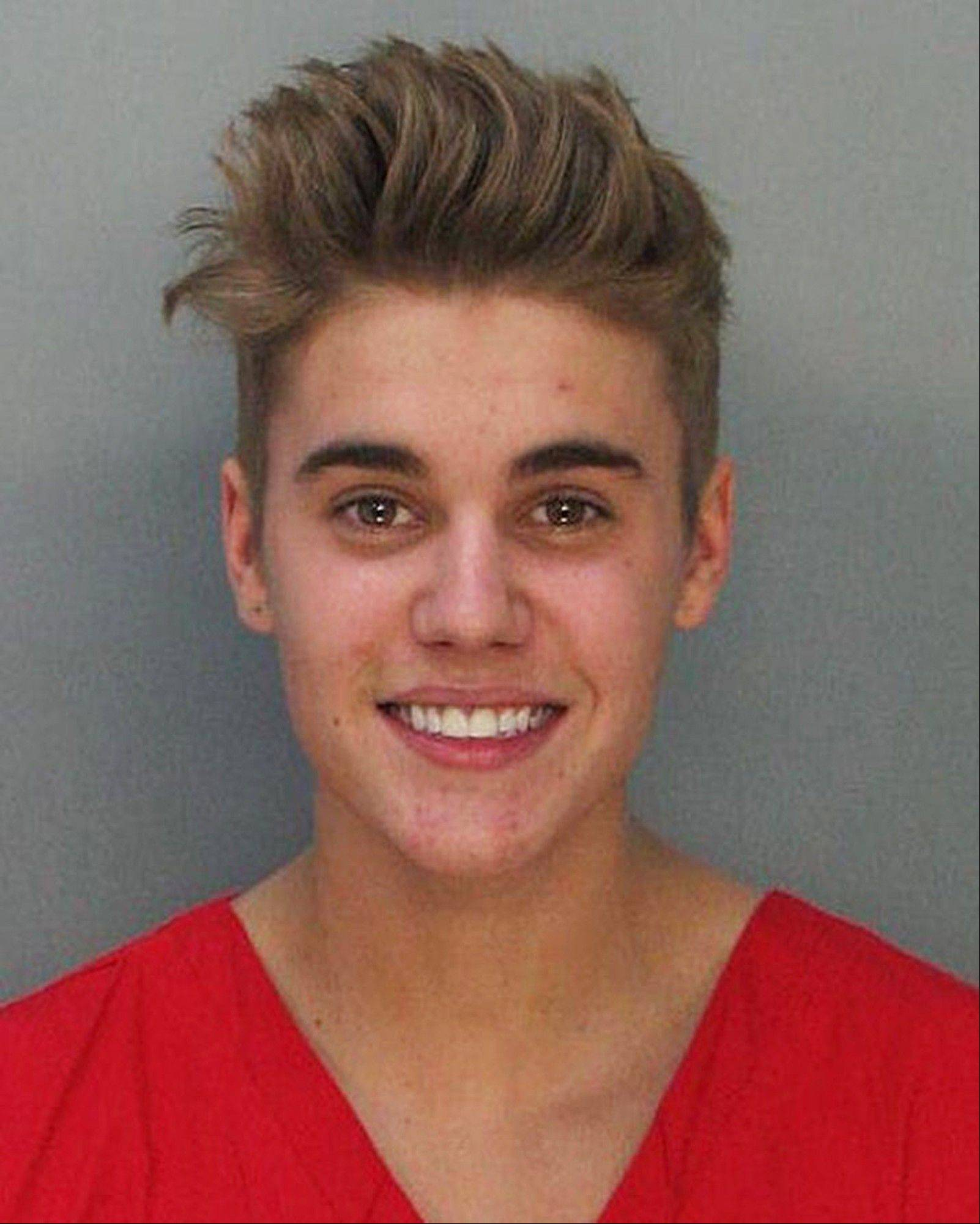 This police booking mug made available by the Miami Dade County Corrections Department shows pop star Justin Bieber on Thursday. Bieber and singer Khalil were arrested on charges of allegedly drag-racing on a Miami Beach Street.