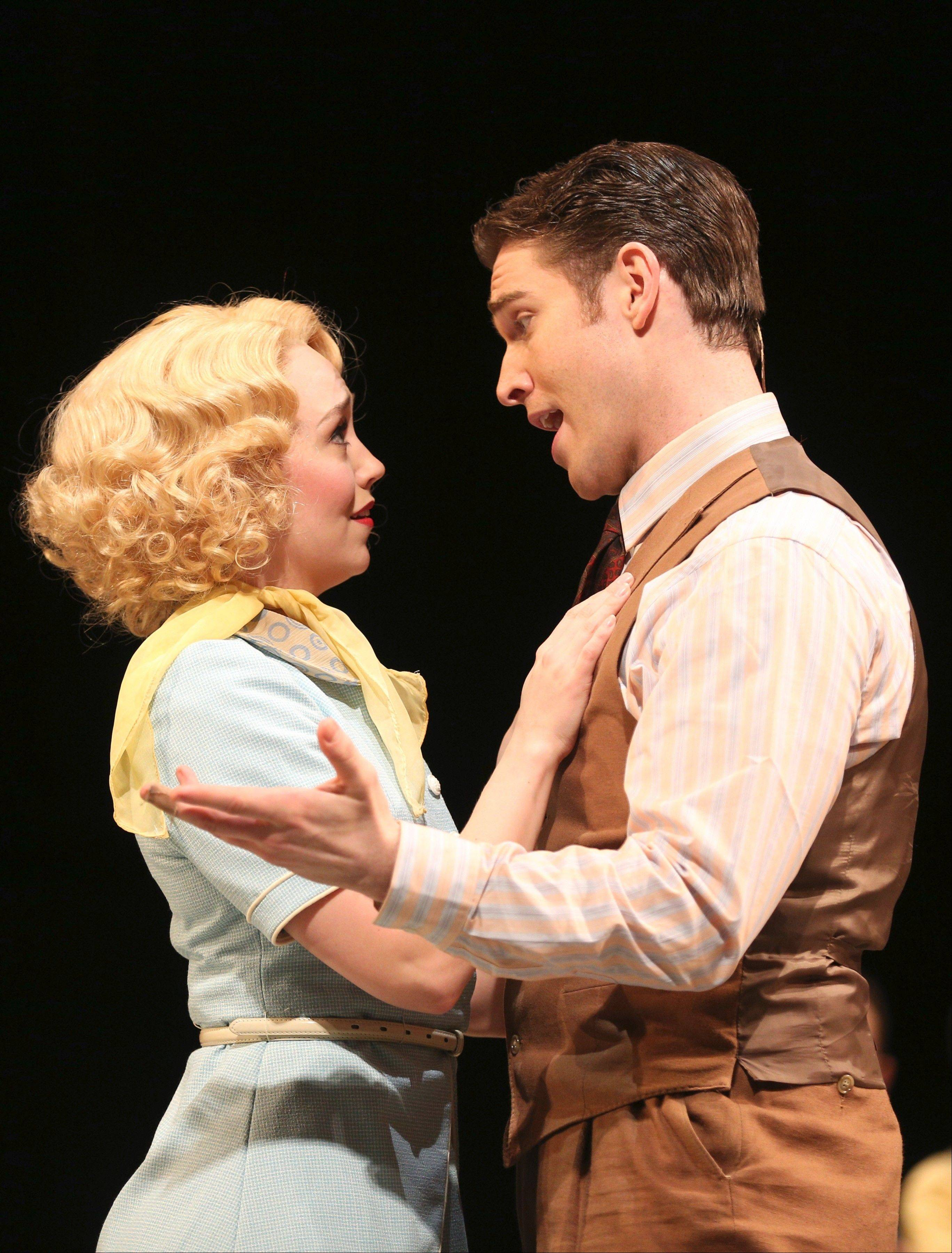 "Peggy Sawyer (Laura Savage) catches the eye of Broadway singer/dancer Billy Lawlor (Tyler Hanes) in Paramount Theatre's revival of ""42nd Street."""