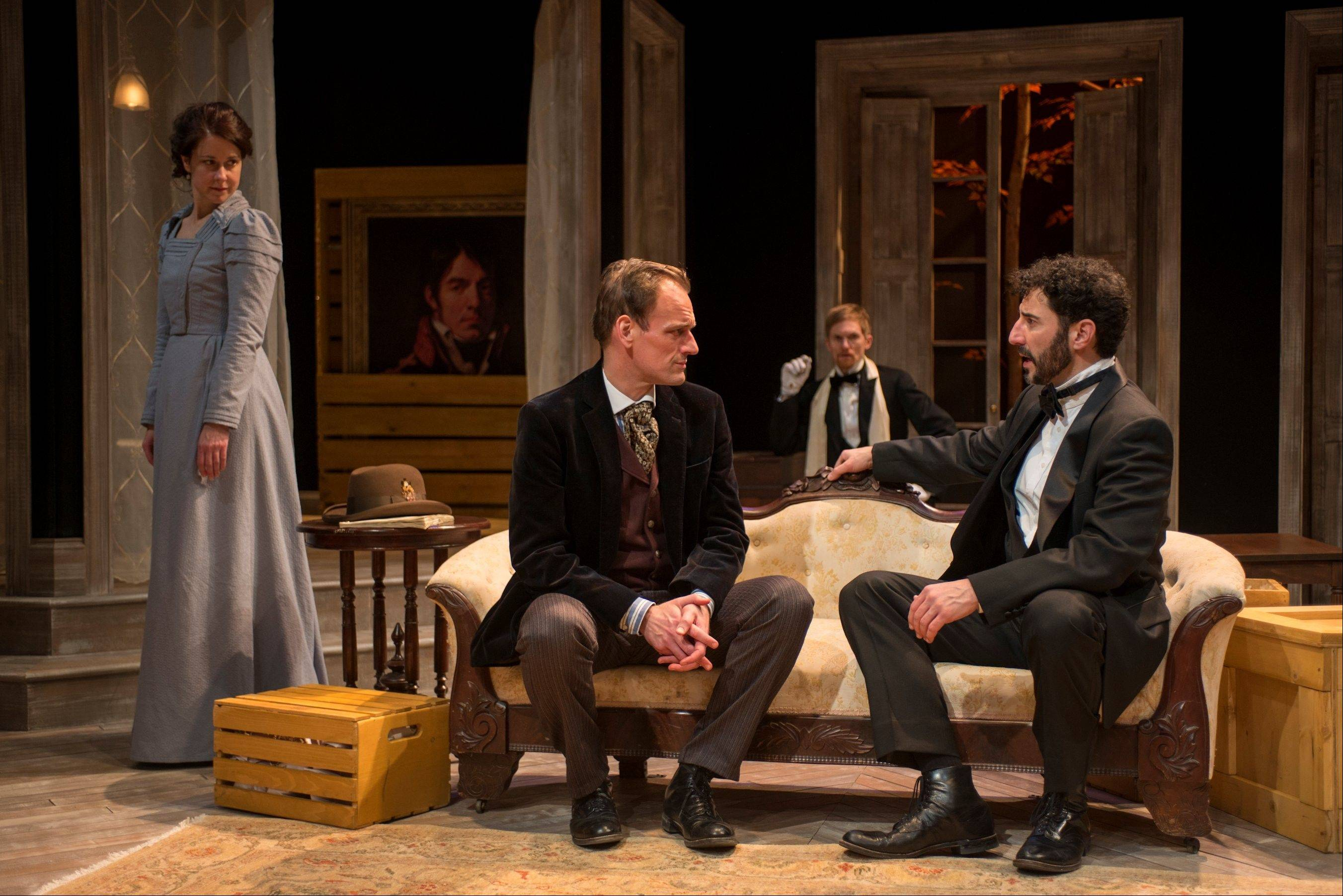 "None of the men orbiting around Kate Fry's Hedda -- including her husband (Sean Fortunato), right, family friend Judge Brack (Scott Parkinson), second from right, and former paramour Eilert (Mark L. Montgomery) -- can match the titular character in Writers Theatre's stellar revival of Henrik Ibsen's ""Hedda Gabler."""