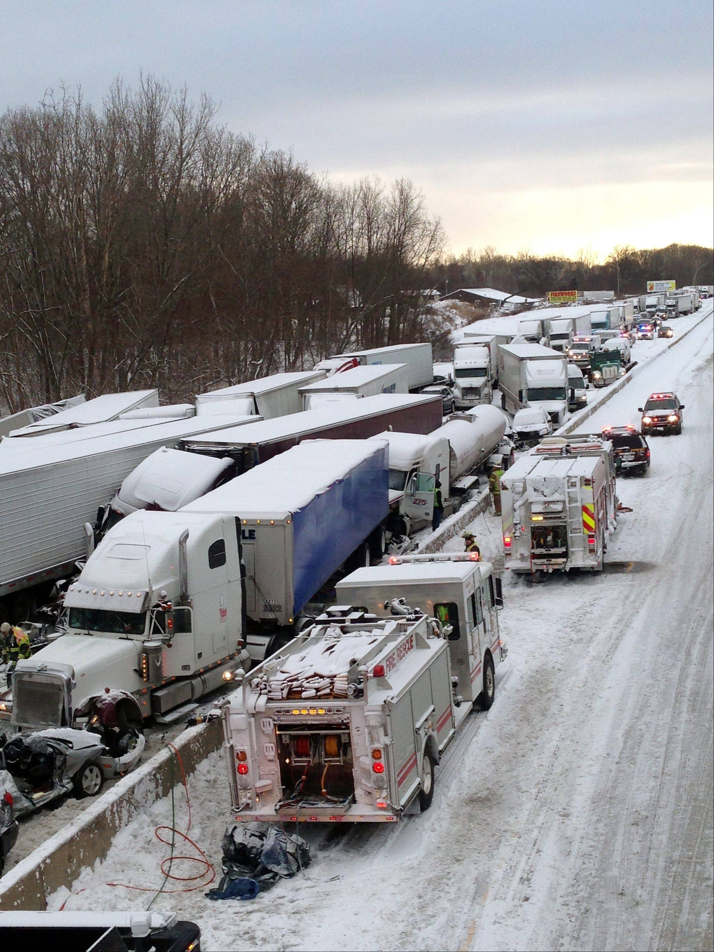 Emergency crews work at the scene of a massive pileup involving more than 40 vehicles, many of them semitrailer trucks, along Interstate 94 Thursday afternoon near Michigan City, Ind.
