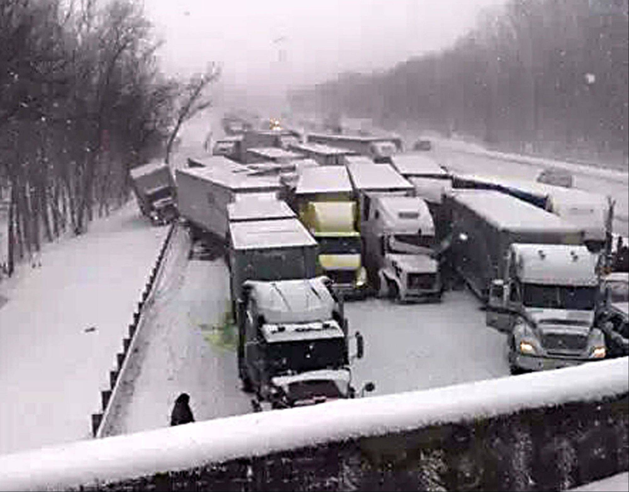 This cellphone image shows a massive highway pileup on Interstate 94 near Michigan City, Ind., Thursday that is being blamed on whiteout conditions. The accident has left three people dead and more than 20 injured in northwestern Indiana. Indiana State Police say they have closed Interstate 94 eastbound and are bringing in cranes and wreckers to help clear the scene.