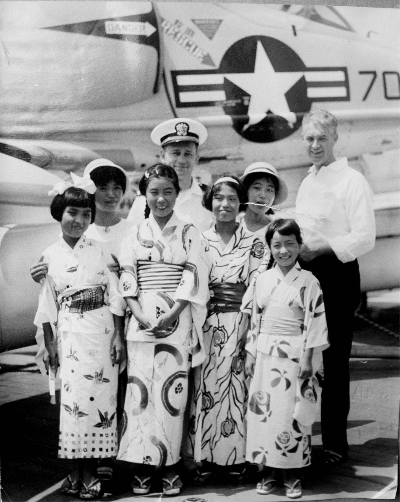 The Rev. Victor Ivers, rear with cap, served 26 years as a Navy chaplain and here poses with schoolchildren in Kobe, Japan, in the early 1960s.