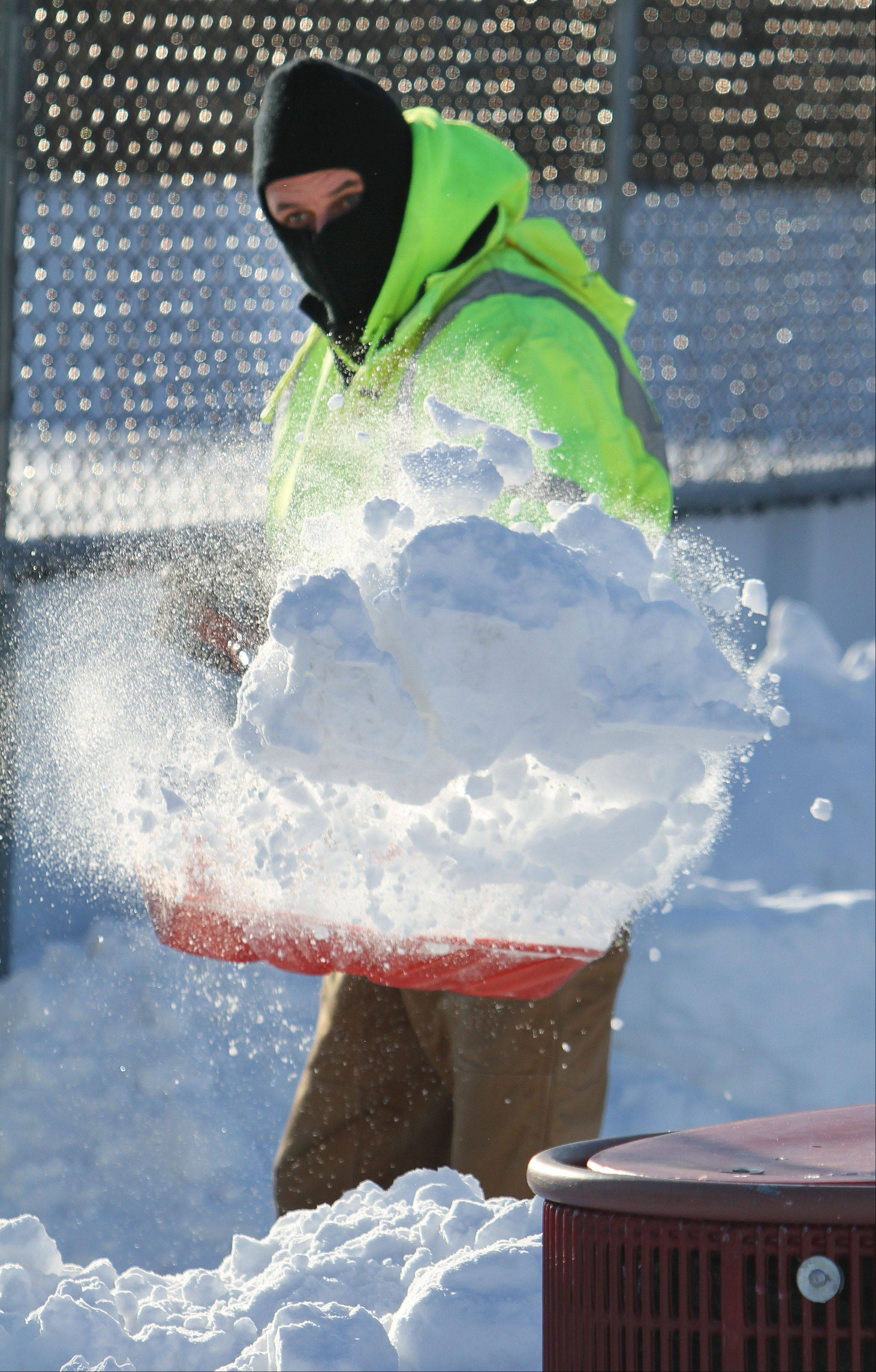 Steve Lundy/slundy@dailyherald.comLibertyville Public Works employee Tom Govekar shovels around the ice rink at Bolander Park in Libertyville as temperatures plummeted Thursday.