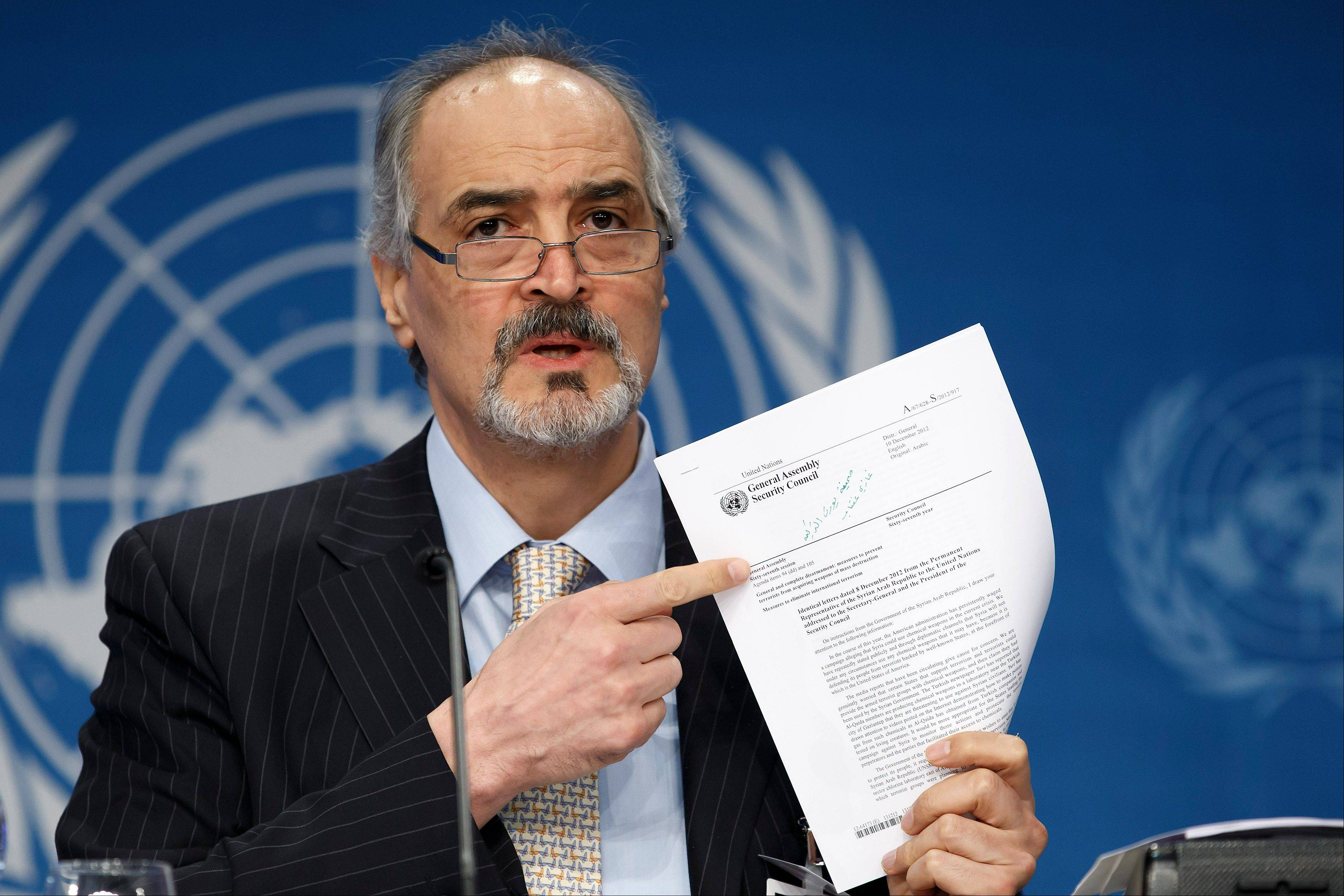 "Syrian Ambassador to the United Nations, Bashar Ja'afari, points to a document during a press conference during the Syrian peace talks in Montreux, Switzerland, Wednesday, Jan. 22, 2014. U.N. Secretary-General Ban Ki-moon opened the meeting saying that the peace talks will face ""formidable"" challenges for Syria. Ban called on the Syrian government and the opposition trying to overthrow it to negotiate in good faith."