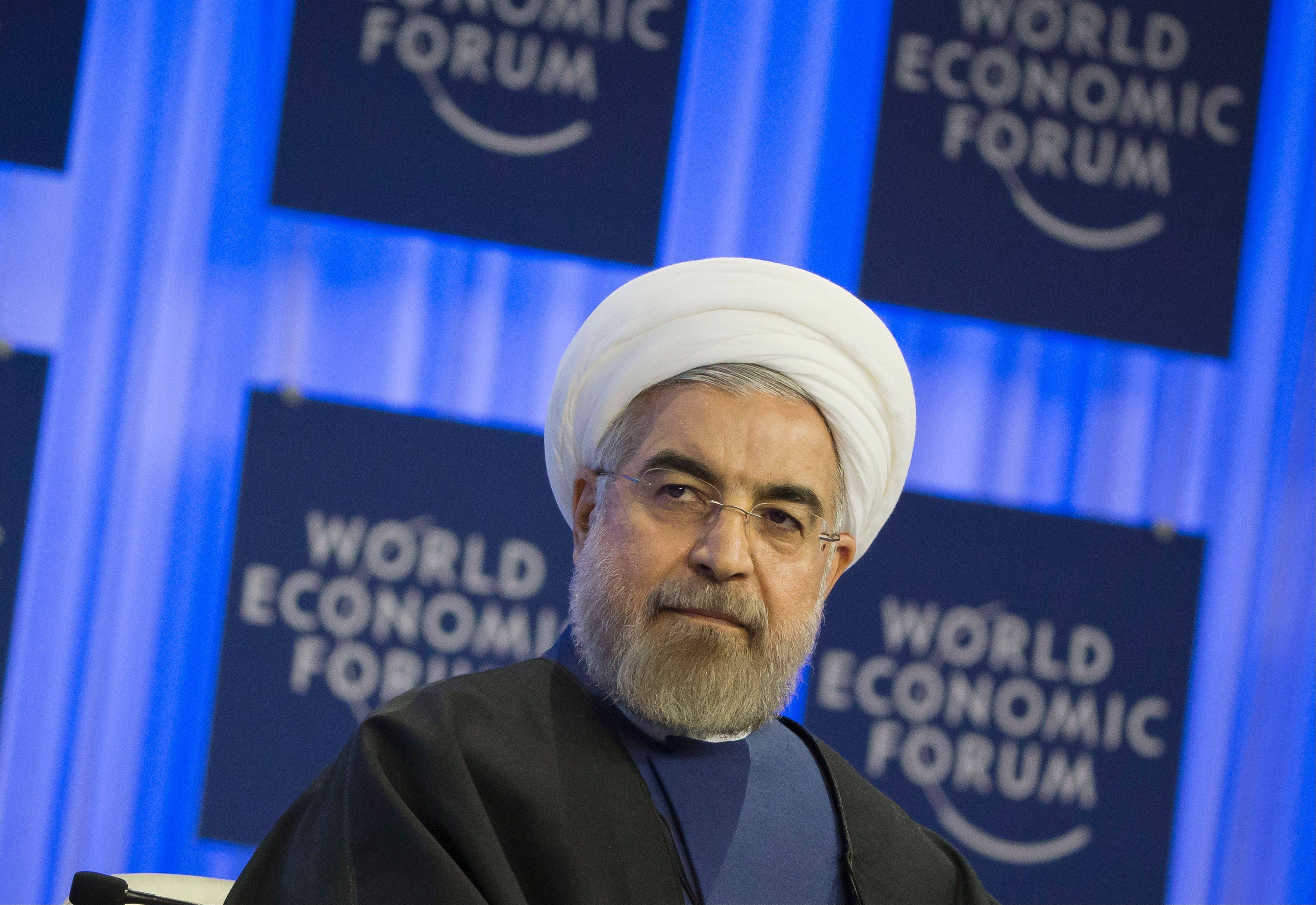 Iranian President Hassan Rouhani listens to welcome remarks during a session of the World Economic Forum in Davos, Switzerland, Thursday, Jan. 23, 2014.