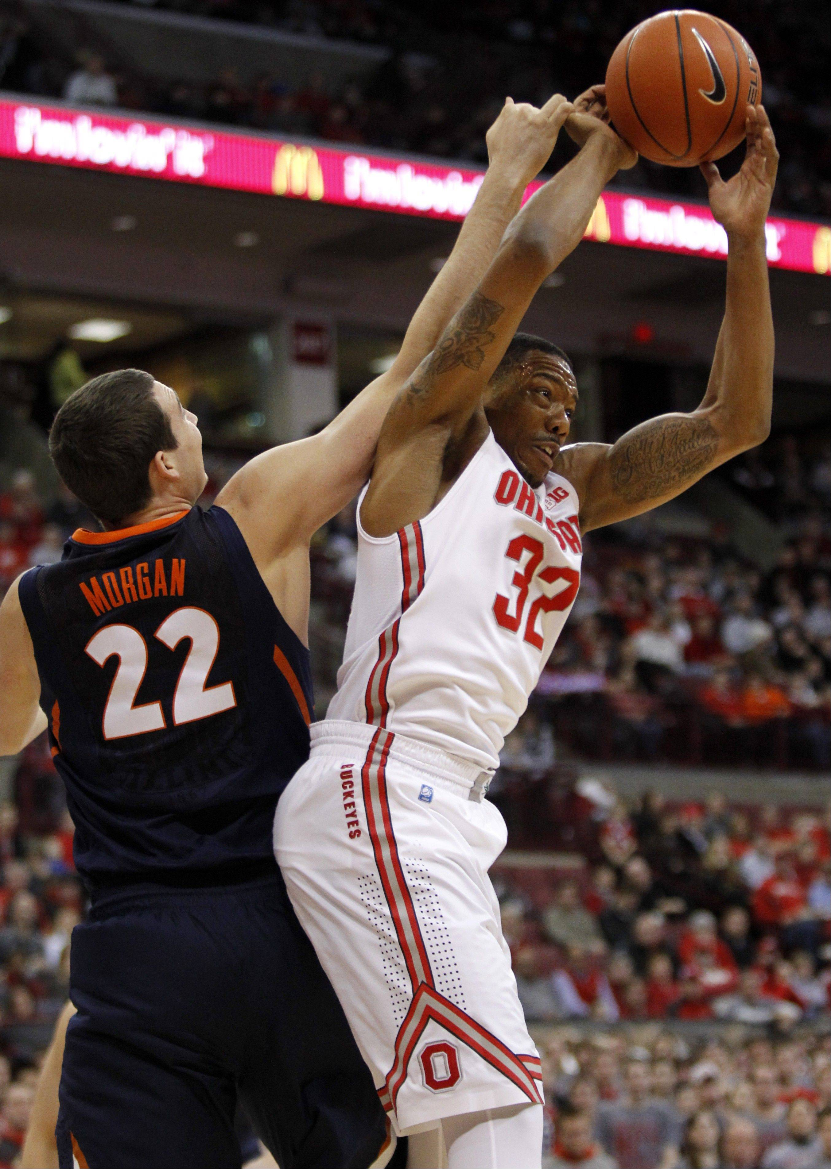 Ohio State's Lenzelle Smith Jr., right, grabs a rebound against Illinois' Maverick Morgan during the first half of an NCAA college basketball game in Columbus, Ohio, Thursday, Jan. 23, 2014. ( AP Photo/Paul Vernon)