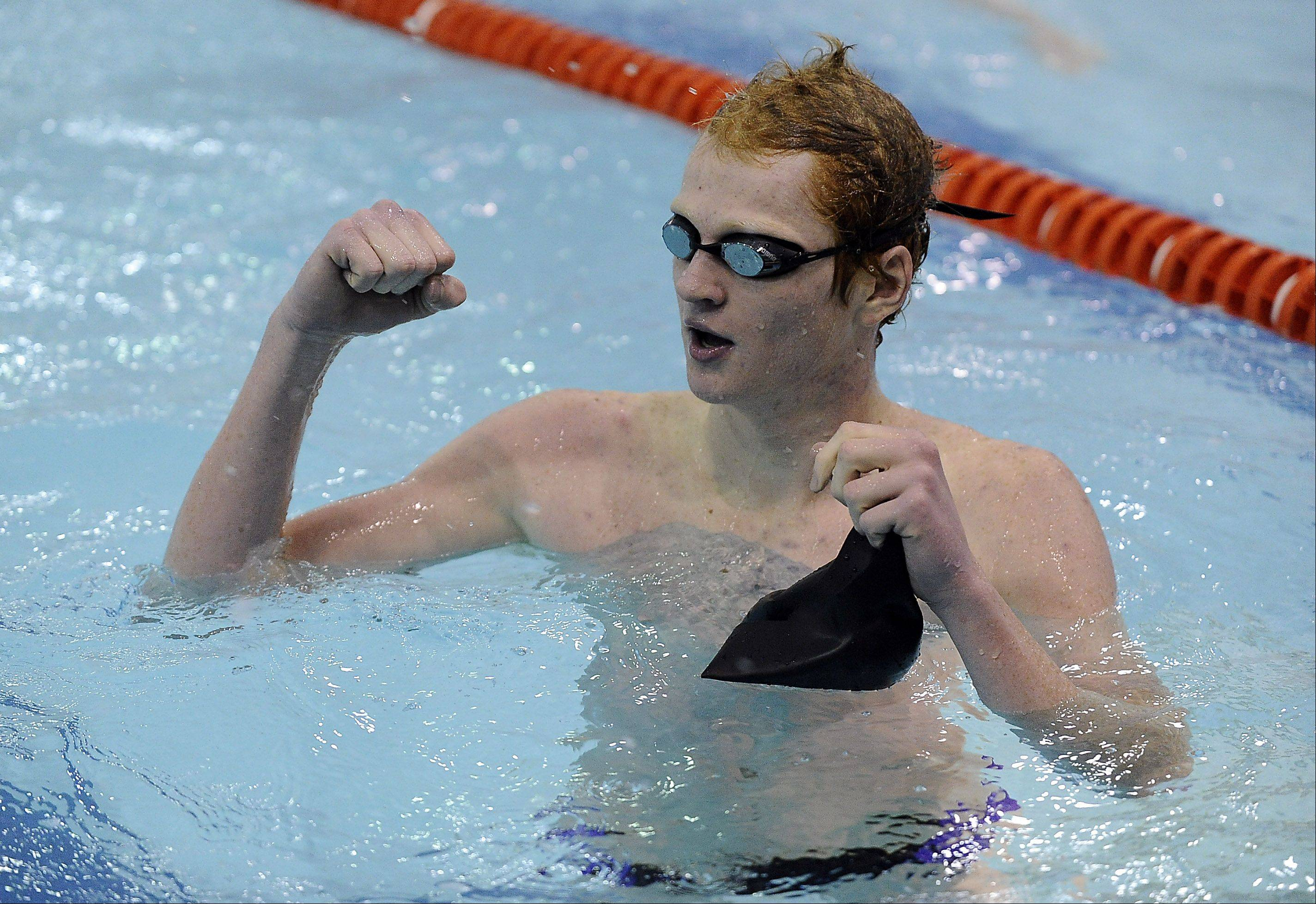 Rolling Meadows' Jake Barson celebrates after a victory in the 200-yard IM race against host Hersey on Thursday.