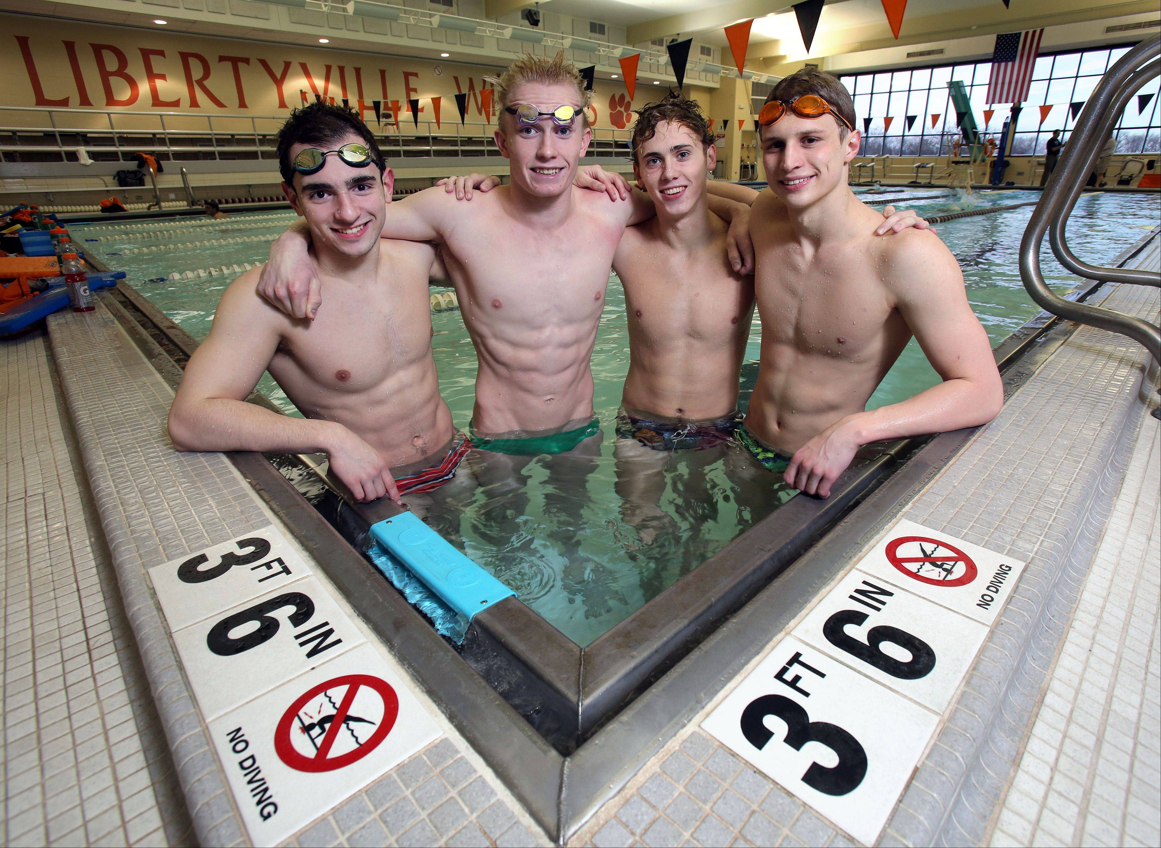 Libertyville swimmers, from left, Matt Harrington, Bobby Snader, Atticus Rush, and Alex Snarski, set pool records at Libertyville in the 200 medley, 200 freestyle and 400 freestyle relays last week. They're after bigger goals in the coming weeks, including a top-three finish in the state meet.