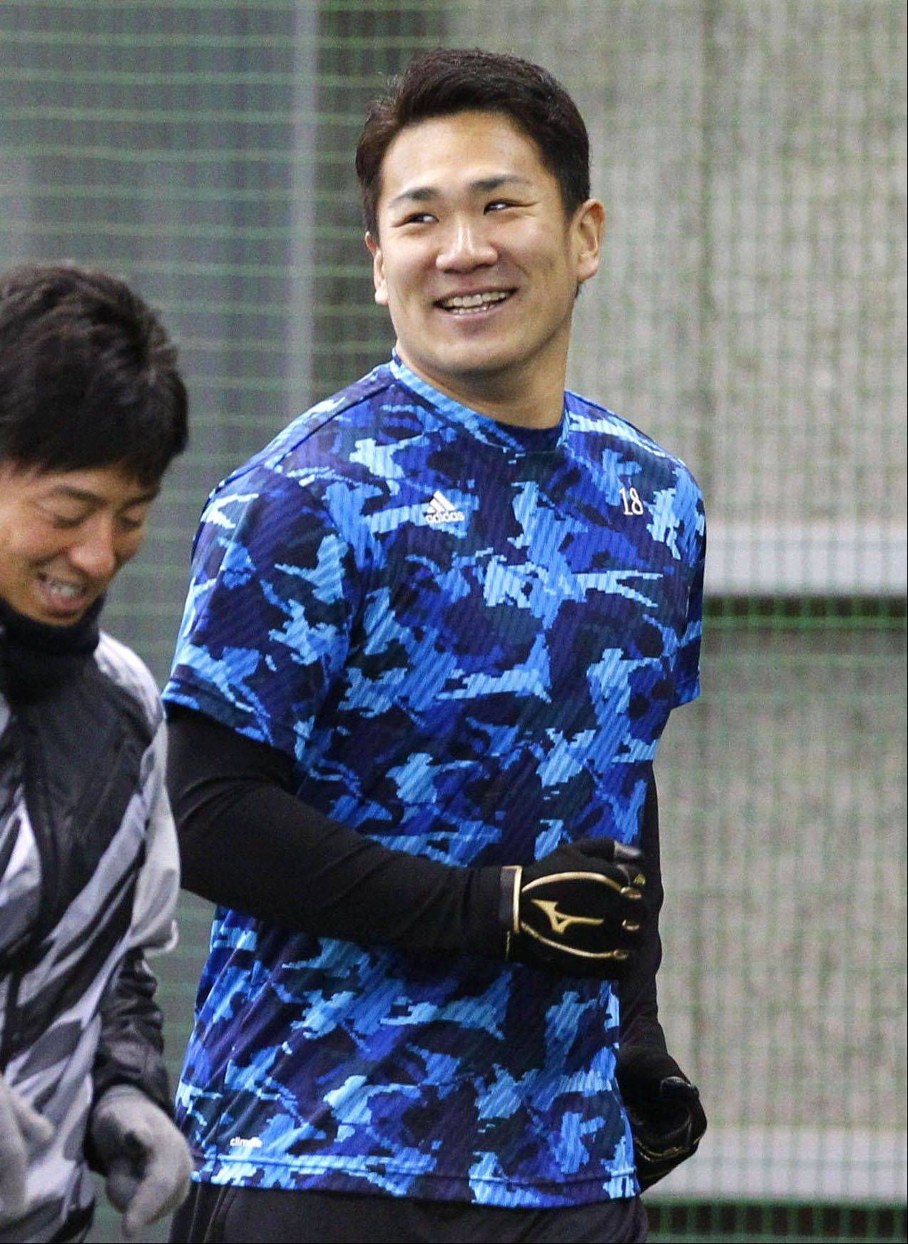 Japanese pitcher Masahiro Tanaka, right, smiles as he runs with his teammate and pitcher Manabu Mima in the morning workout at the Rakuten Golden Eagles' indoor training facility in Sendai, northeastern Japan, Thursday morning, Jan. 23, 2014. The New York Yankees capped an offseason spending spree by agreeing Wednesday, Jan. 22 to a $155 million, seven-year contract with prized 25-year-old right-hander Tanaka. (AP Photo/Kyodo News) JAPAN OUT, CREDIT MANDATORY