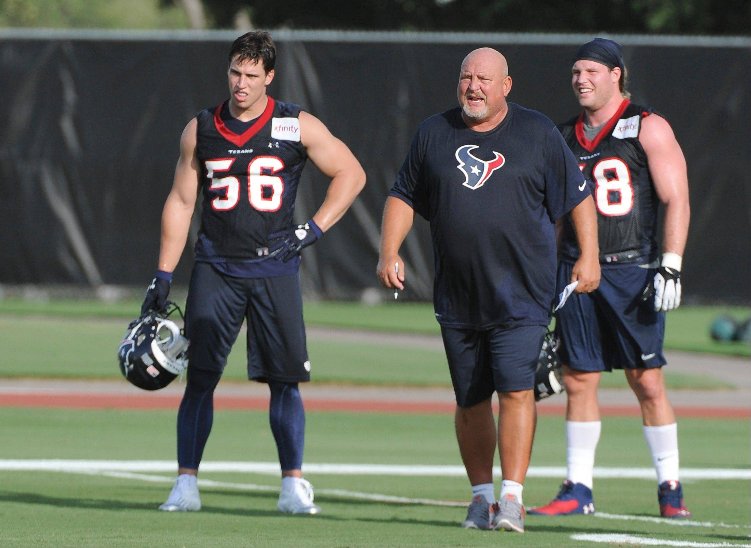 Former Houston Texans linebackers coach Reggie Herring, center, has been hired by the Chicago Bears to coach their linebackers.