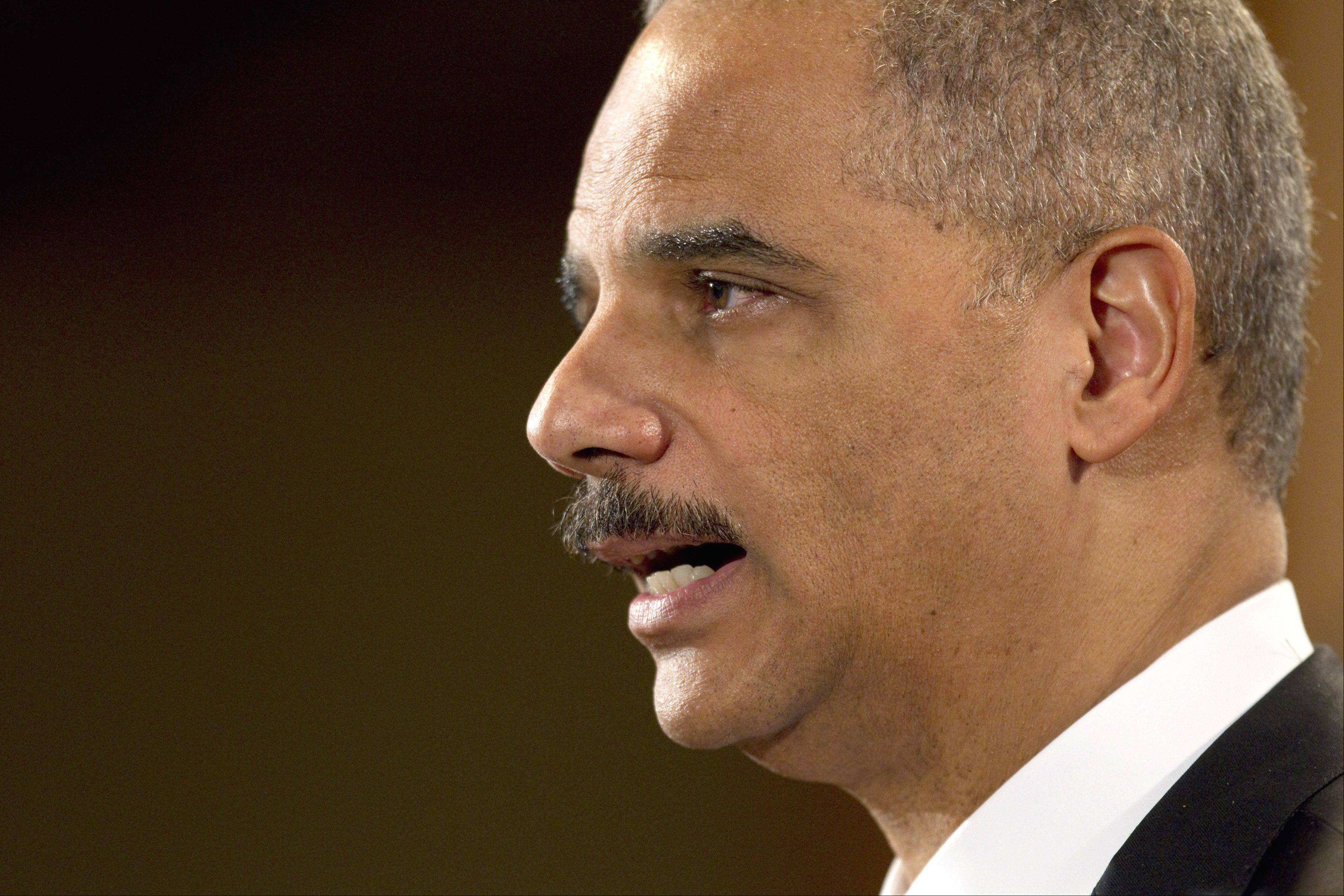Attorney General Eric Holder says the Obama administration is planning to roll out regulations soon that would allow banks to do business with legal marijuana sellers.