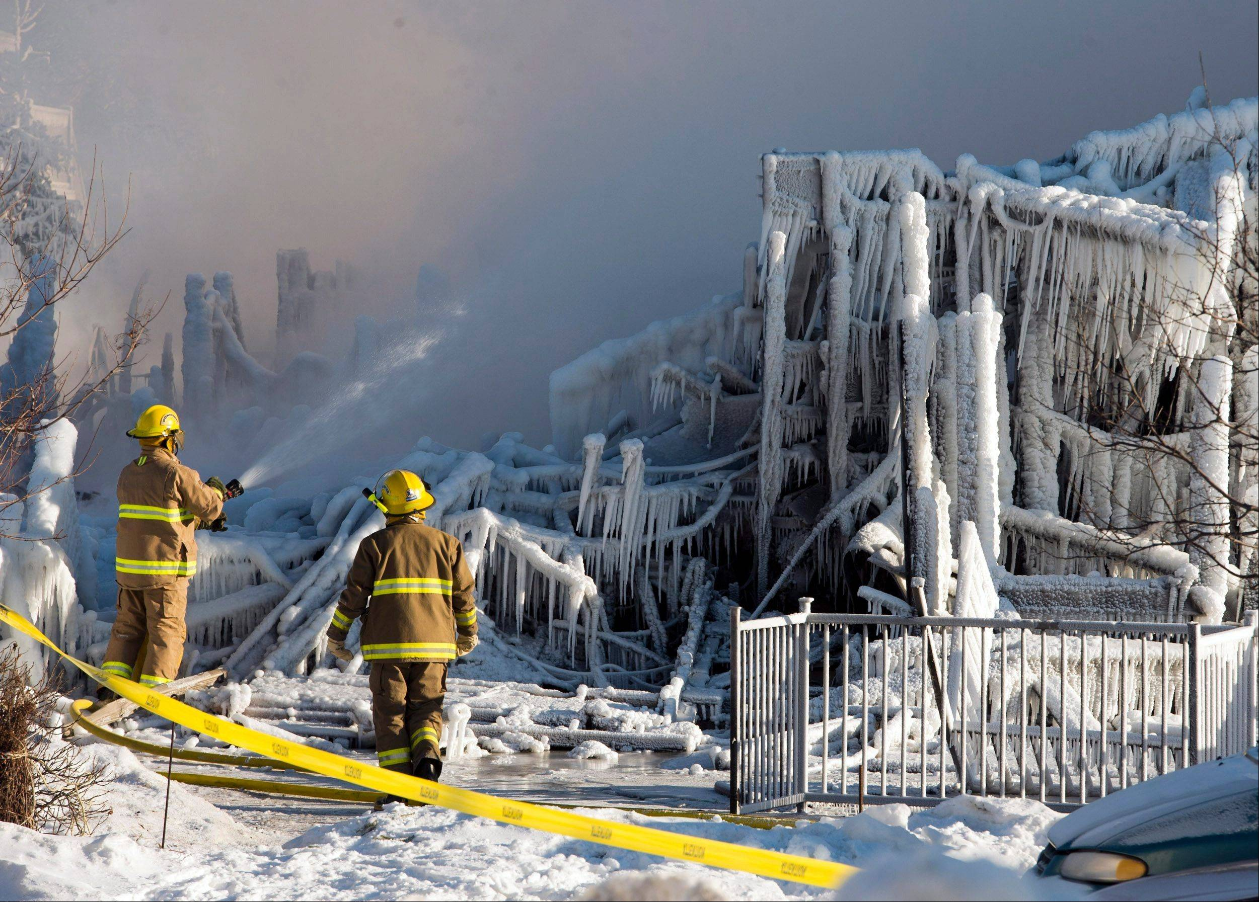 Firefighters continue to douse the rubble where fire destroyed a senior residence leaving at least five people dead and 30 unaccounted for in L�Isle-Verte, Que., Thursday, Jan. 23, 2014 The fire trapped terrified residents, most of them dependent on wheelchairs and walkers.