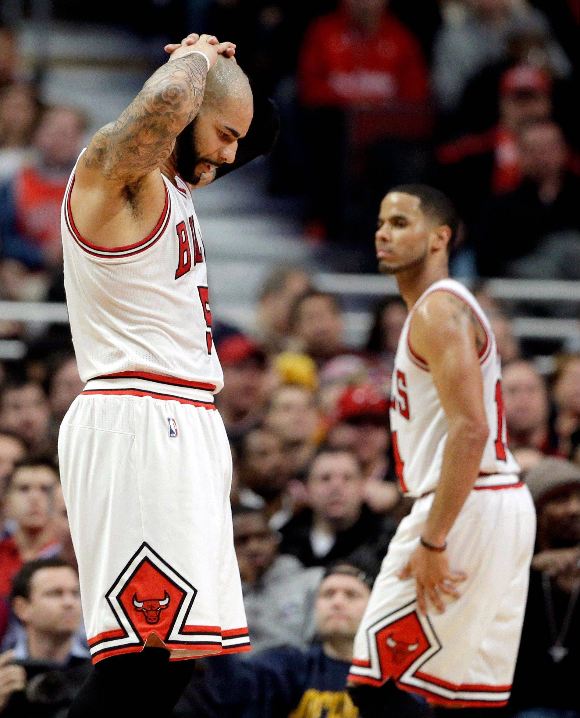 Carlos Boozer (5), left, and D.J. Augustin (14) react after the Clippers� Darren Collison was fouled in the second half of the Bulls� loss on Friday at the United Center.