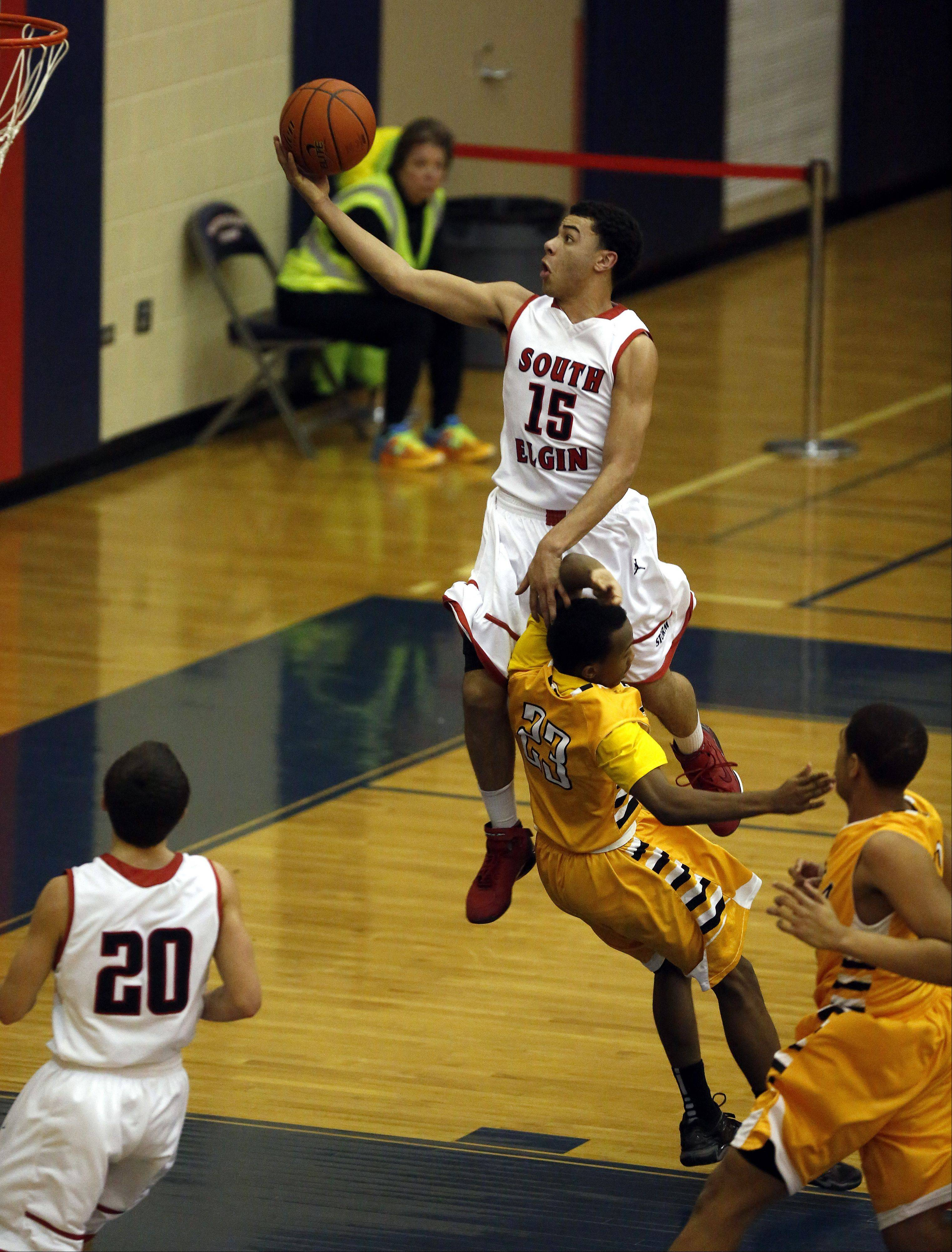 South Elgin�s Matthew Smith goes up and over Metea Valley�s Ron Edwards Jr. at South Elgin Friday.