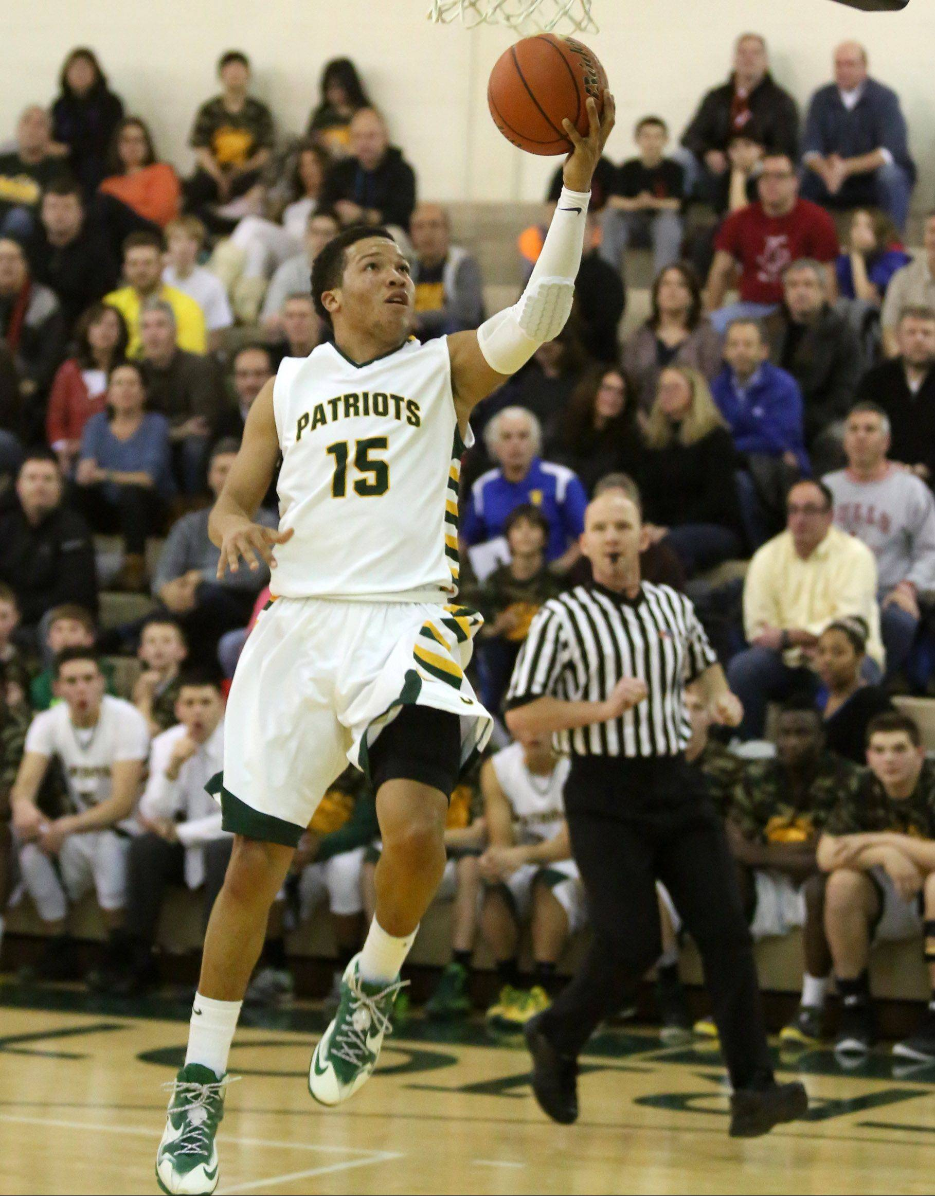 Stevenson�s Jalen Brunson gets free for a drive to basket against Libertyville at Stevenson on Friday.