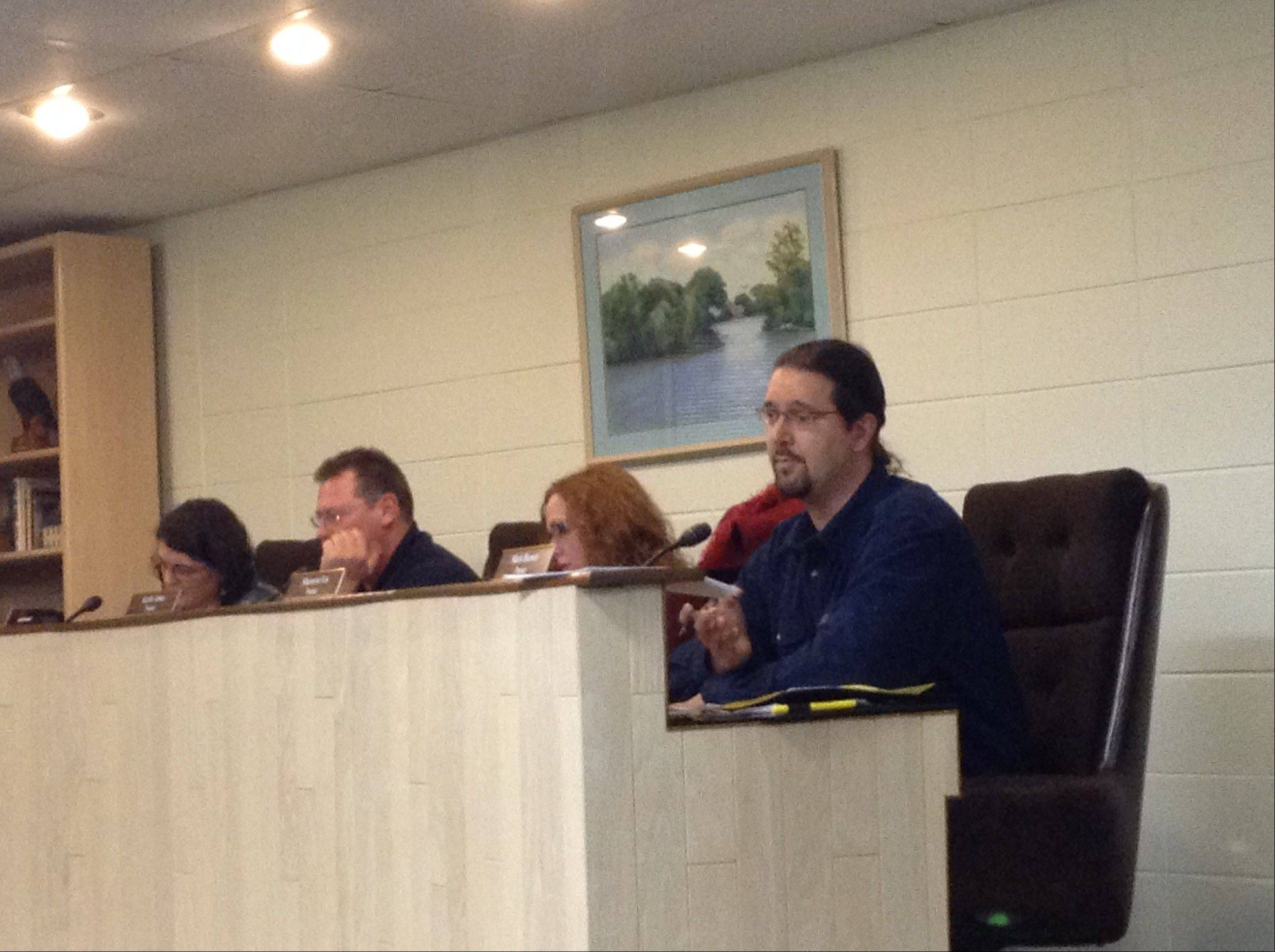 Island Lake Trustee Mark Beeson, right, explains his opposition to video gambling at Thursday's board meeting.