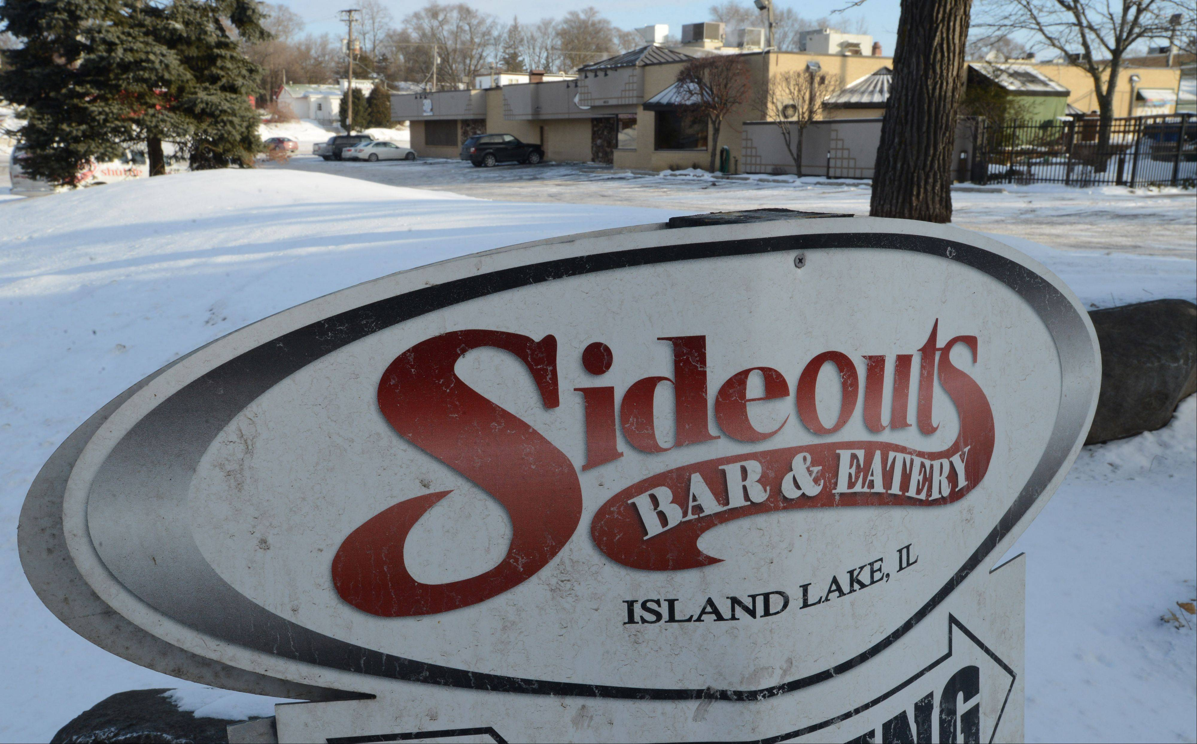 Jerry DeLaurentis, owner of Sideouts Bar & Eatery in Island Lake, wants video gambling machines in his business and is angry about the village's ban.