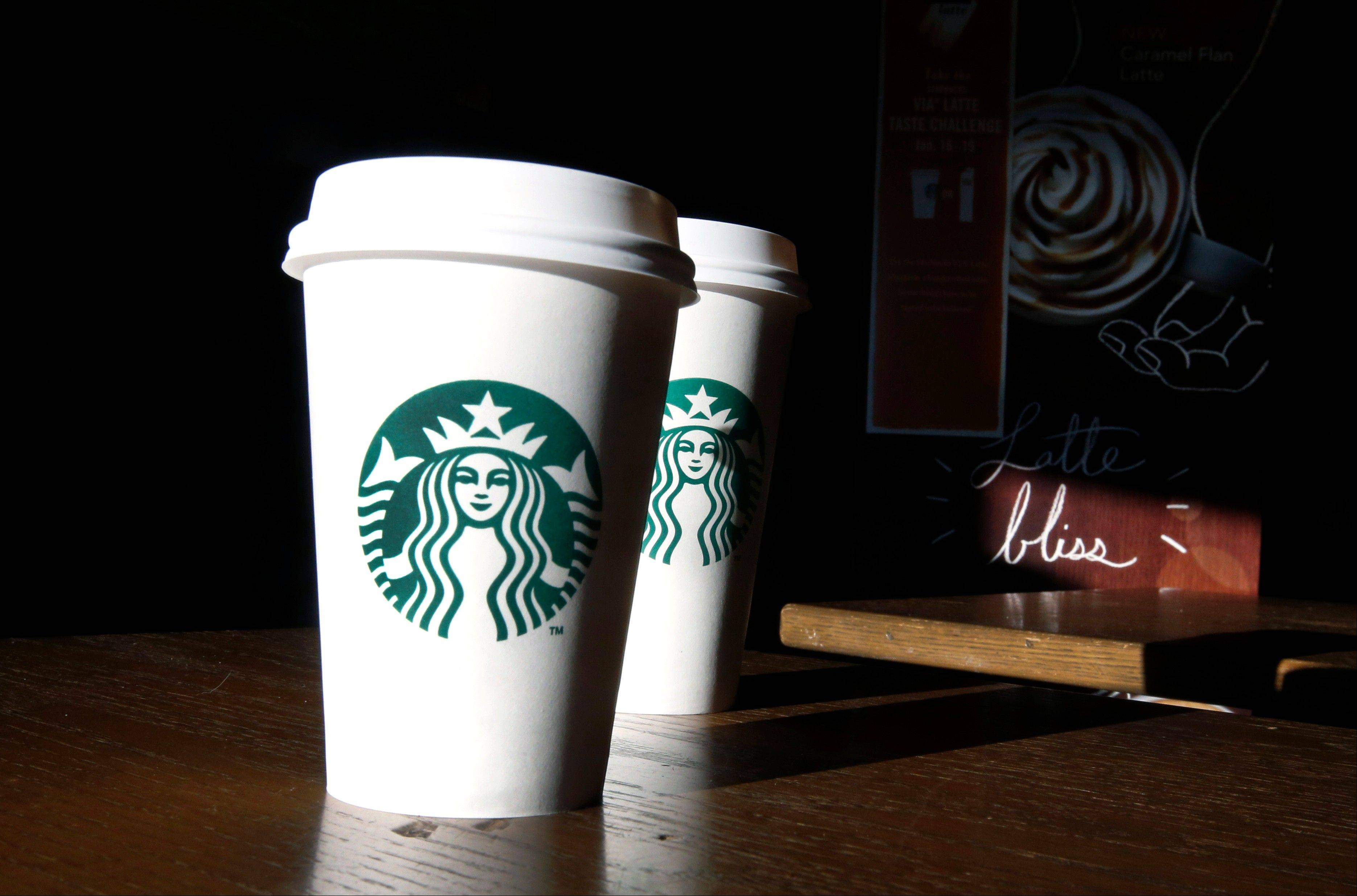 Starbucks says its quarterly profit rose by 25 percent as it benefited from lower coffee costs and stronger sales around the world.