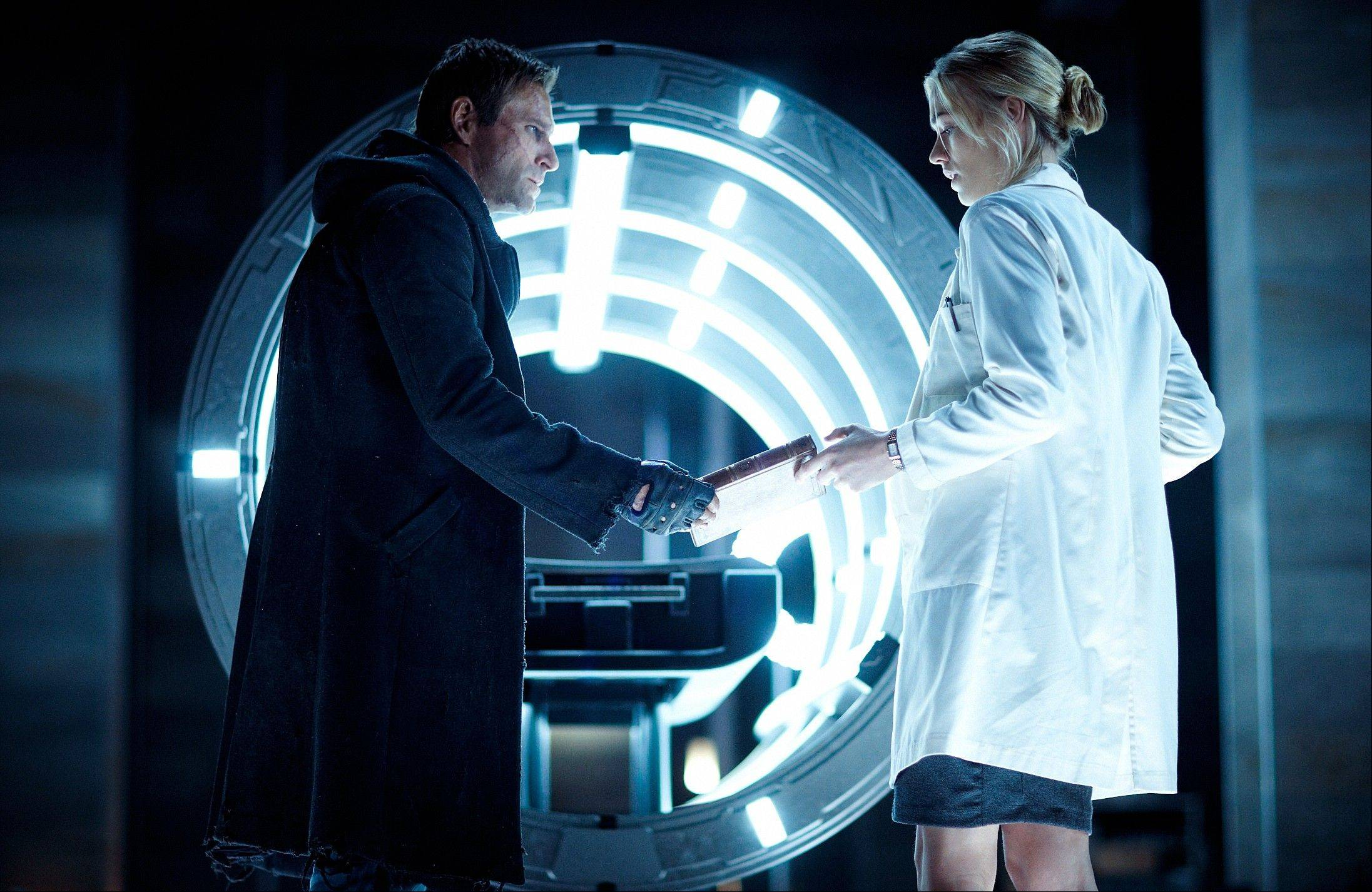 "Aaron Eckhart, left, and Yvonne Strahovski star in ""I, Frankenstein."""