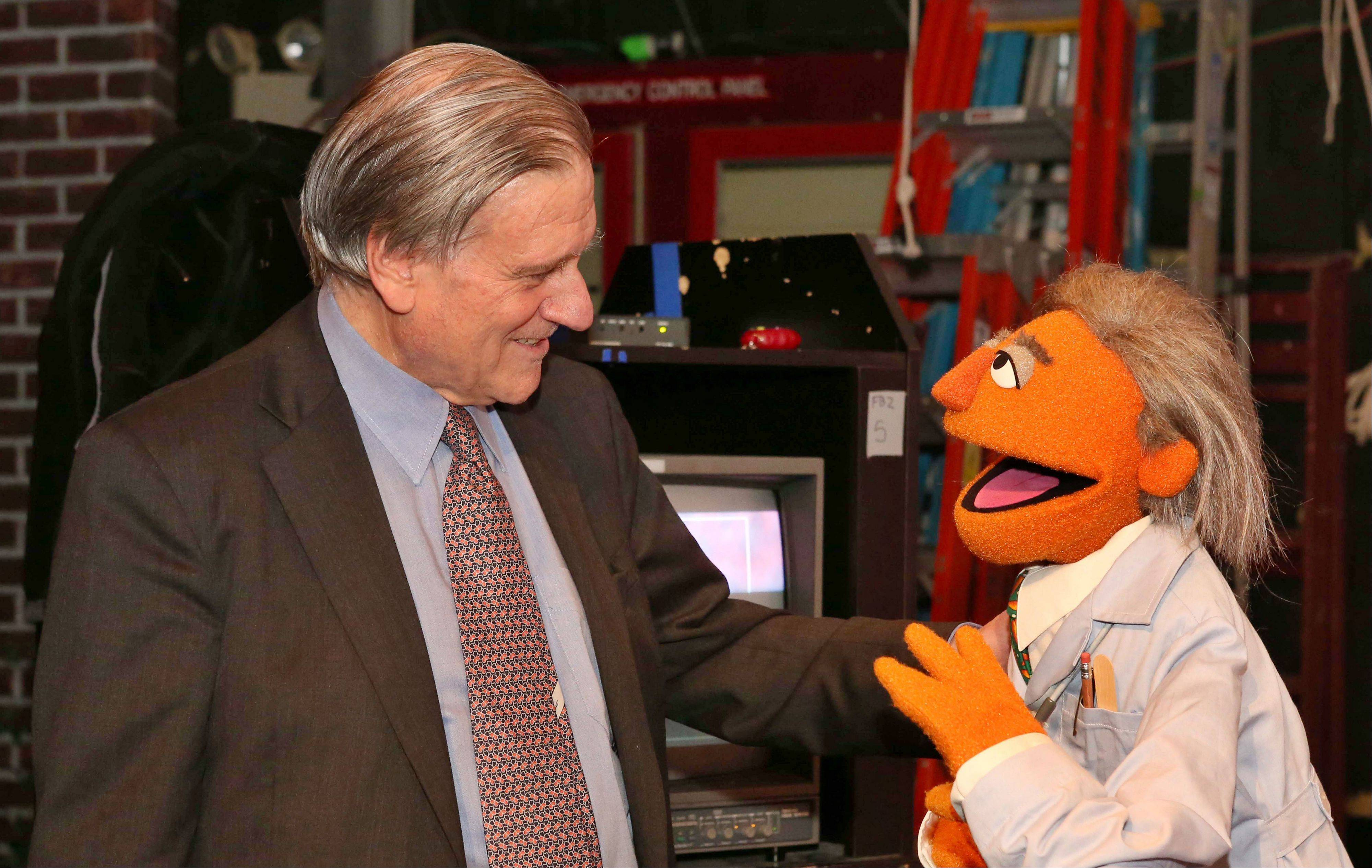 "Dr. Valentin Fuster, a cardiologist at New York's Mount Sinai Hospital, with a Muppet character based on him, ""Dr. Ruster."" Fuster has teamed up with Sesame Street on a project to improve kids' health and fight childhood obesity nationwide."