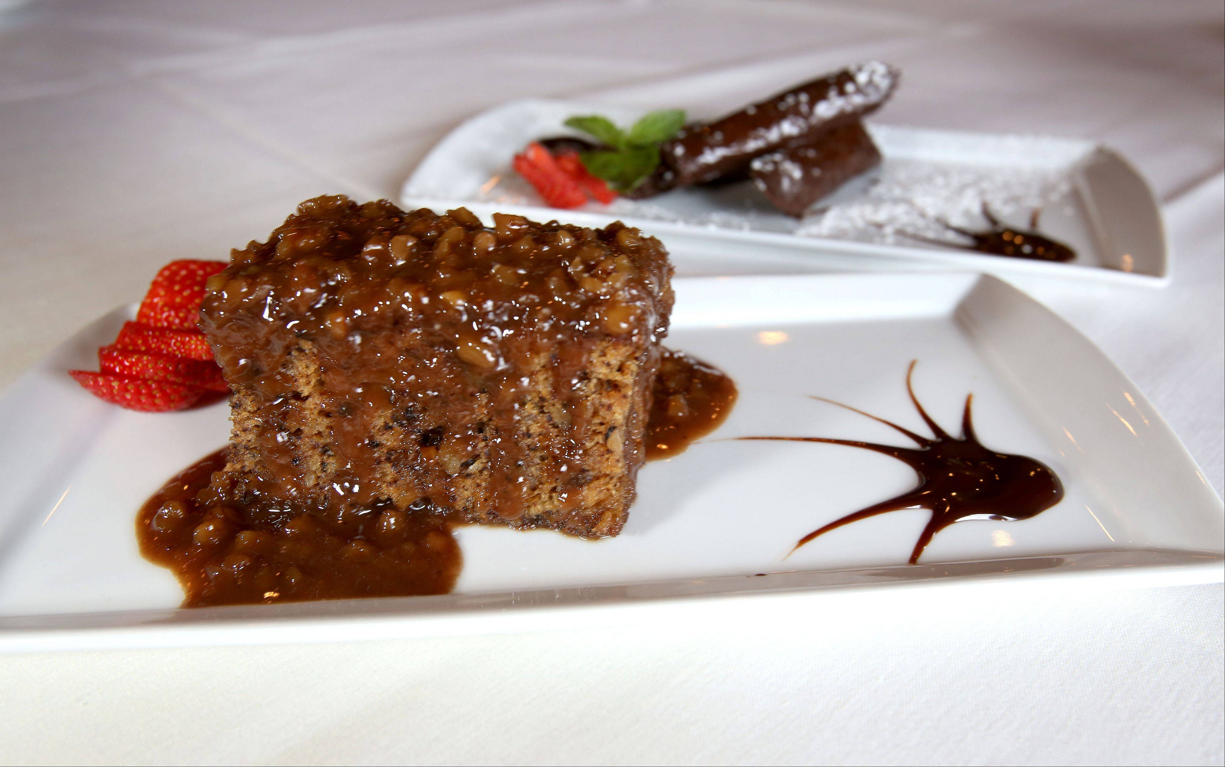 Angela's walnut cake and chocolate baklava are two sweet options for dessert at Basil's Greek Dining in Aurora.