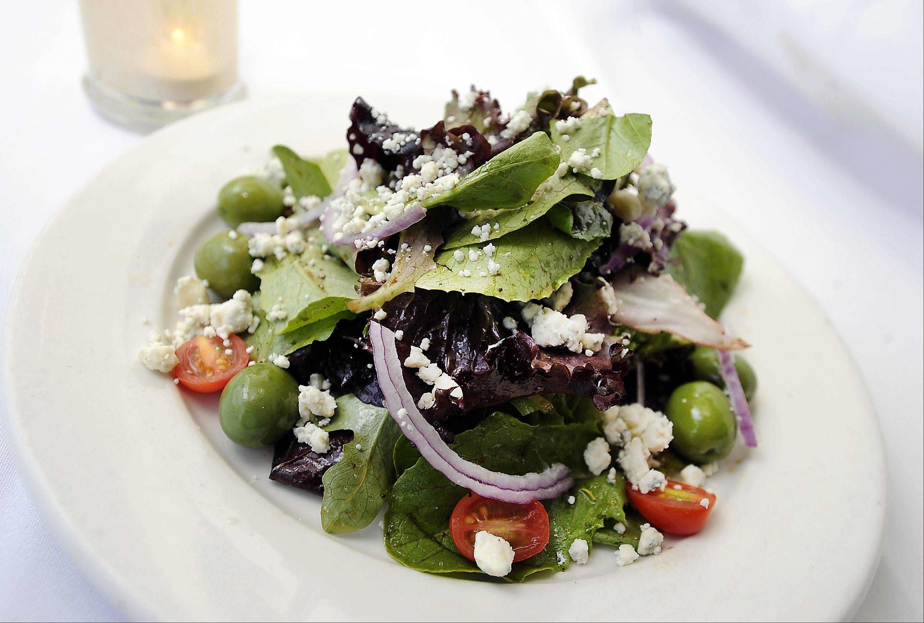 Green olives accent the signature salad at Enzo & Lucia Ristorante and Cafe in Long Grove.