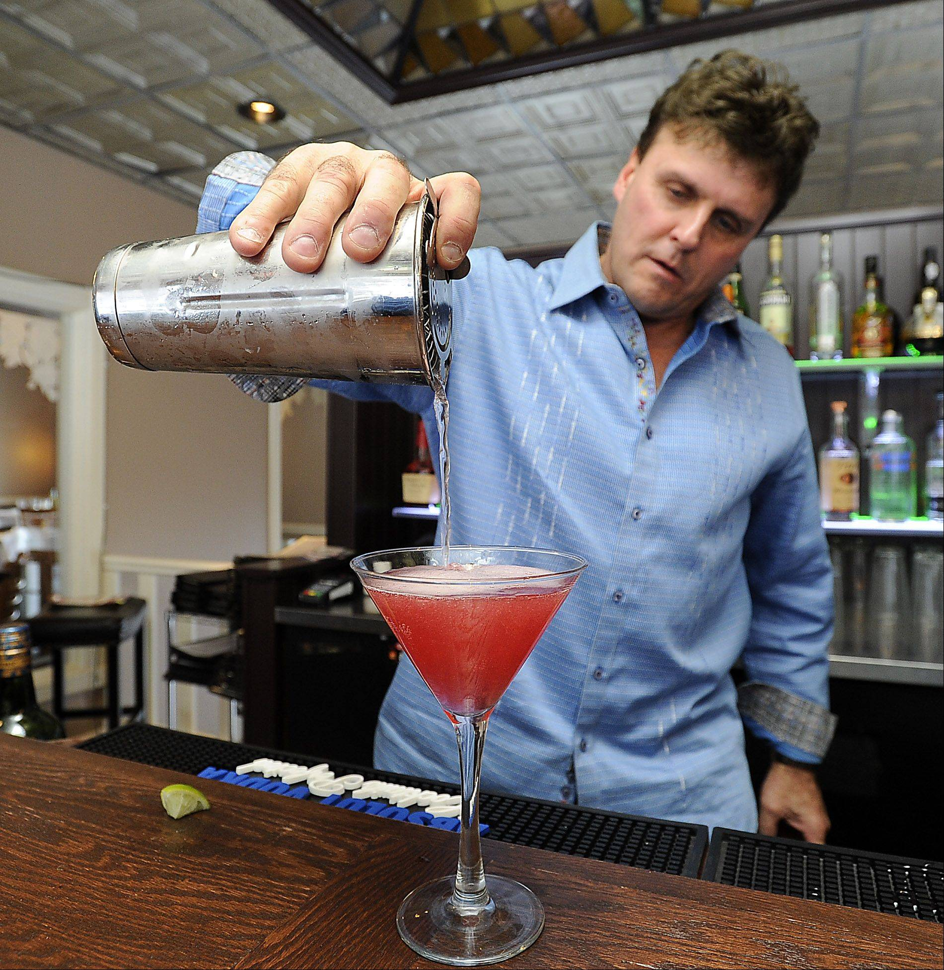 Owner Glenn Cardelli mixes a drink in the newly remodeled Enzo & Lucia Ristorante and Cafe in Long Grove.