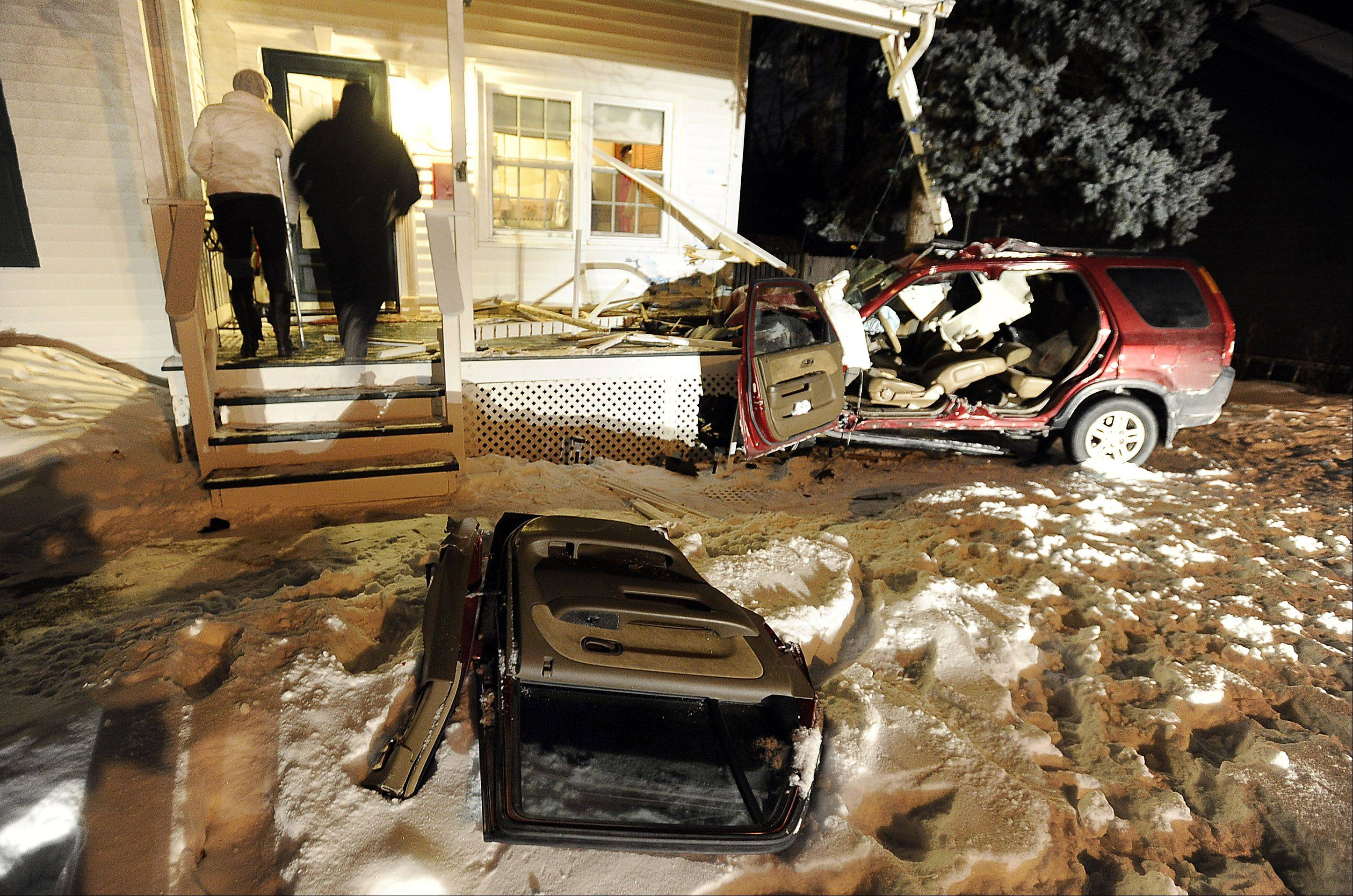 "An SUV traveling at a ""pretty good"" rate of speed crashed into a house Thursday night in Arlington Heights, police said."